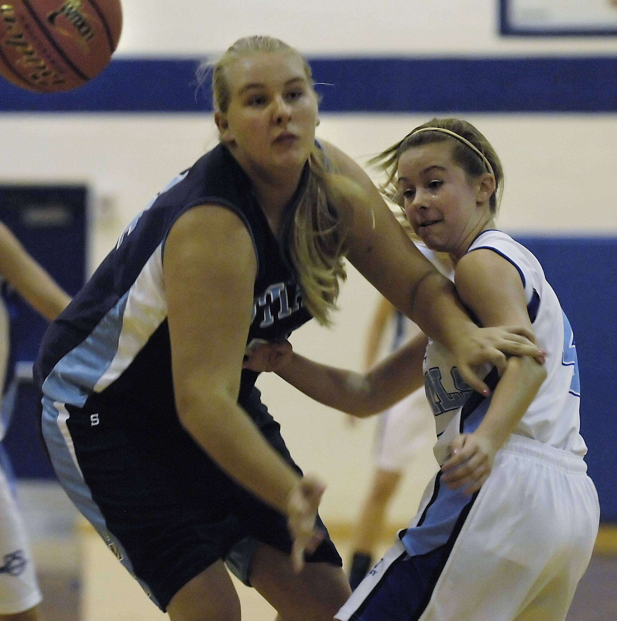 Illinois Math and Science Academy's Melissa Perkns keeps Rosary guard Taylor Gibson away from the ball Monday in Aurora.
