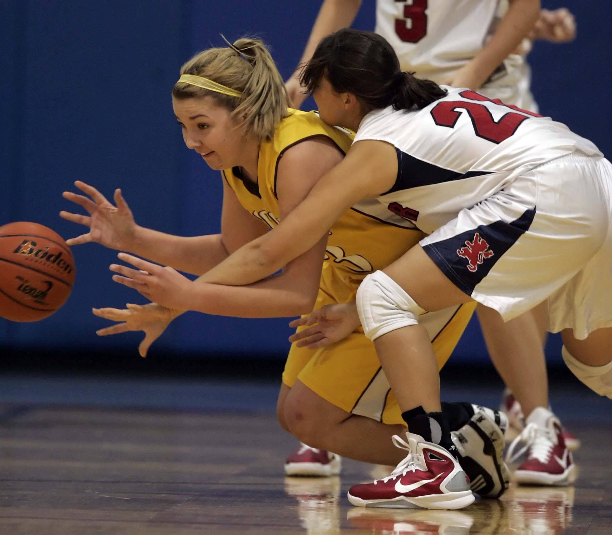 Jacobs' Melanie Schwerdtmann, 23, and St. Viator's St. Viator guard Katie Calmeyn, 21, battle for a loose ball Friday at the Dundee-Crown tournament.