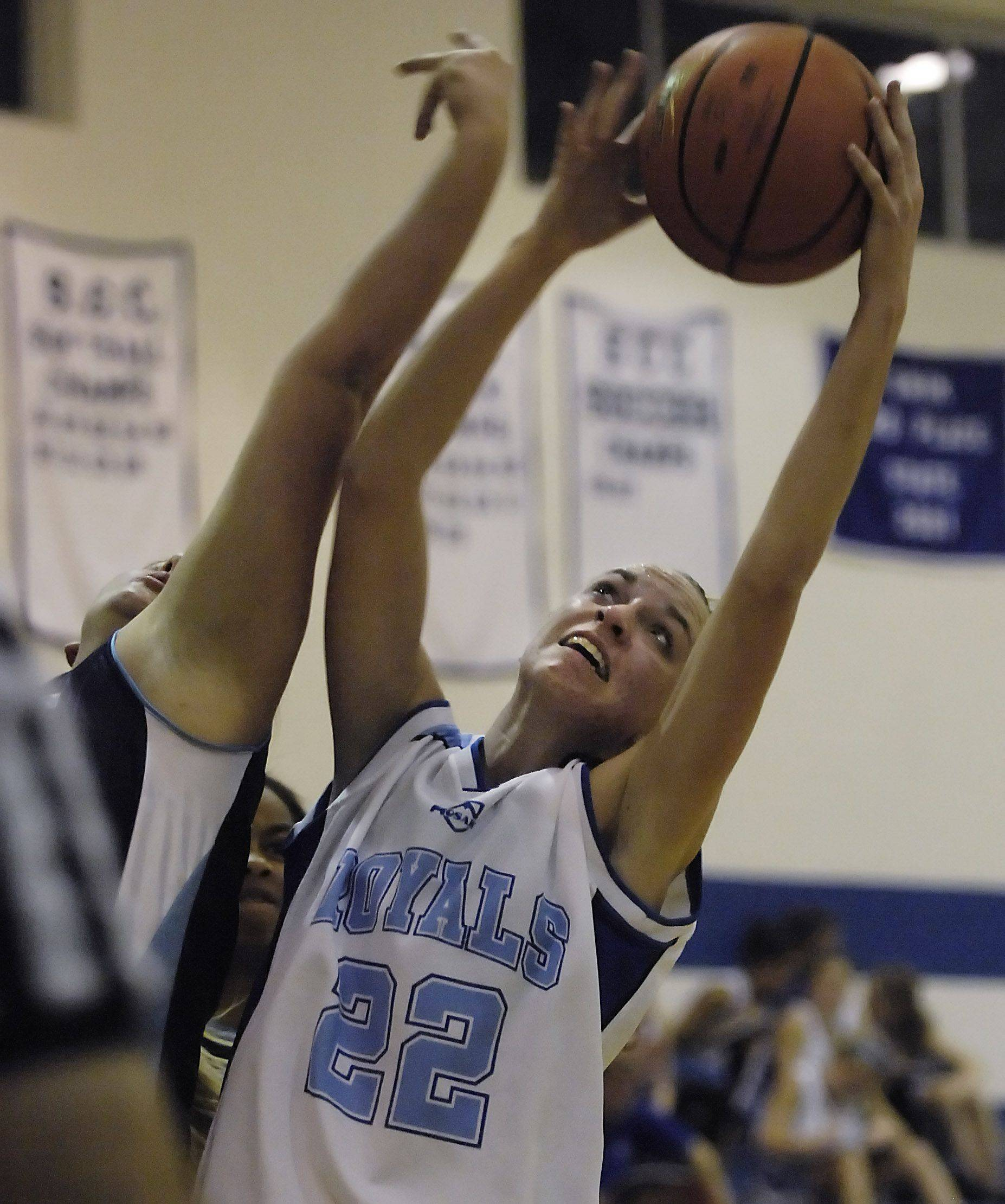 Rosary's Breann Maryanski takes a rebound Monday in Aurora.