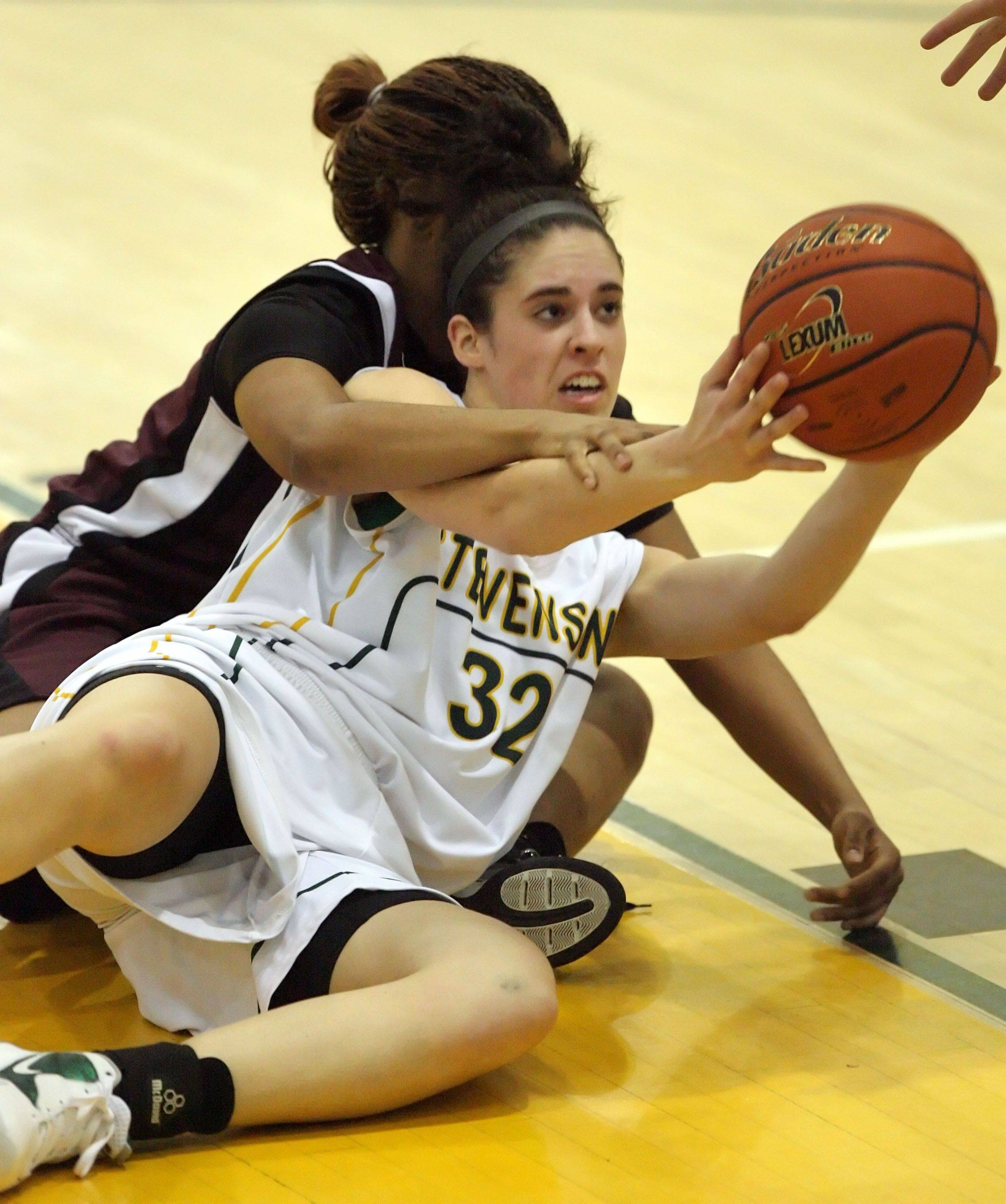 Stevenson's Anna Morrissey fights for a rebound with Zion-Benton's Helena Rodriguez duing their game Monday night in Lincolnshire.