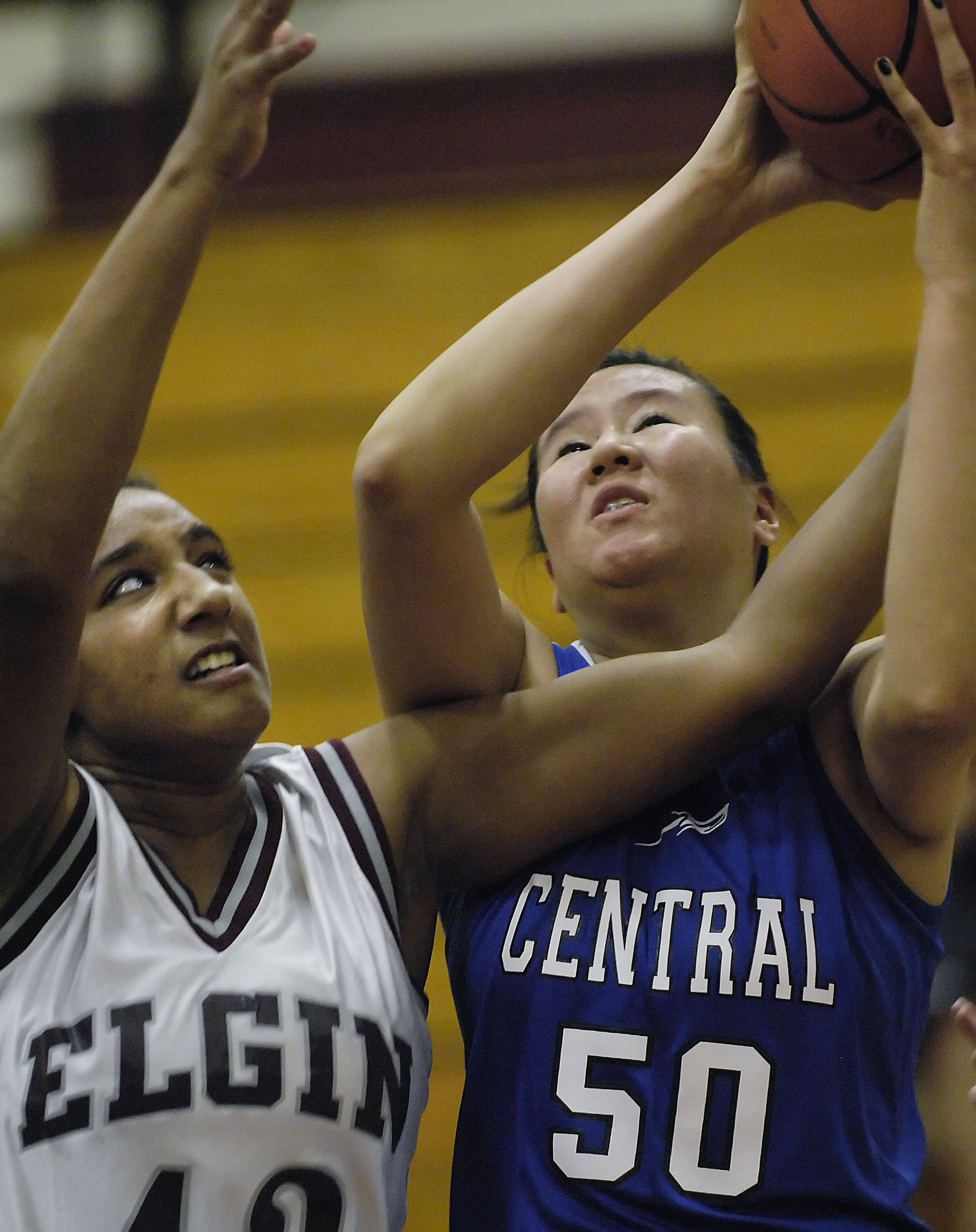 Elgin's Maria Panthier reaches for the ball held by Burlington Central's Brenda Thasavong Tuesday.