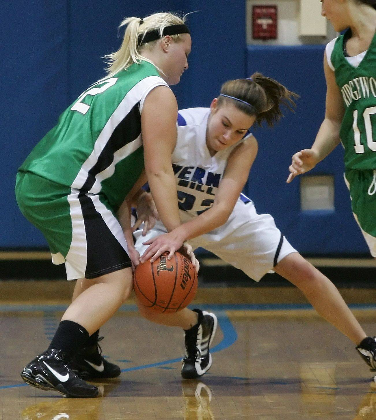 Vernon Hills' Brie Bahlmann steals the ball from Ridgewood guard Tara Coyle during basketball action Thursday in Vernon Hills.