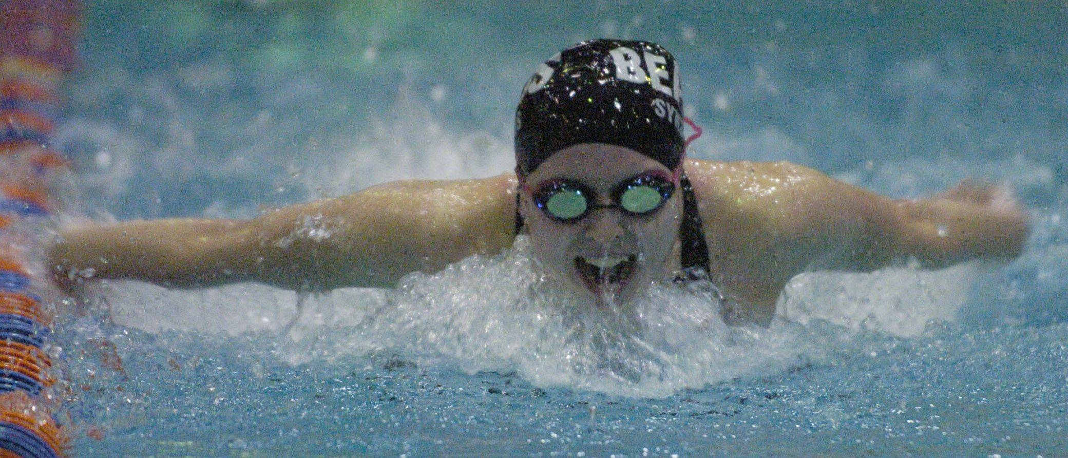 Rosary's Sarah Sykstus swims the 100-yard butterfly during Friday's girls state swimming prelims at Evanston High School.