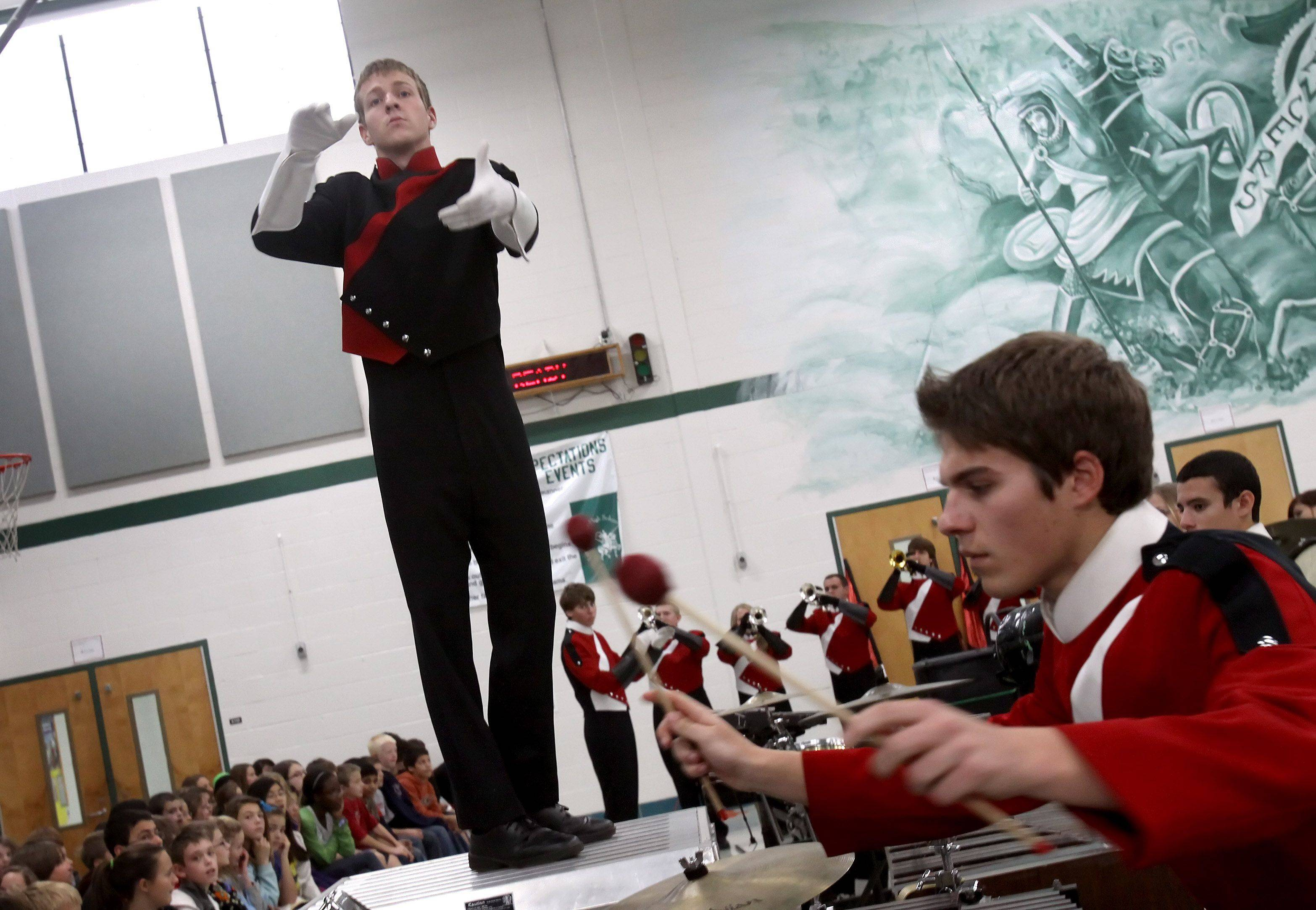 No seat at the kids table this year for Naperville Central senior Alex Reeder; he's leading the marching band in the Macy's Thanksgiving Day Parade.