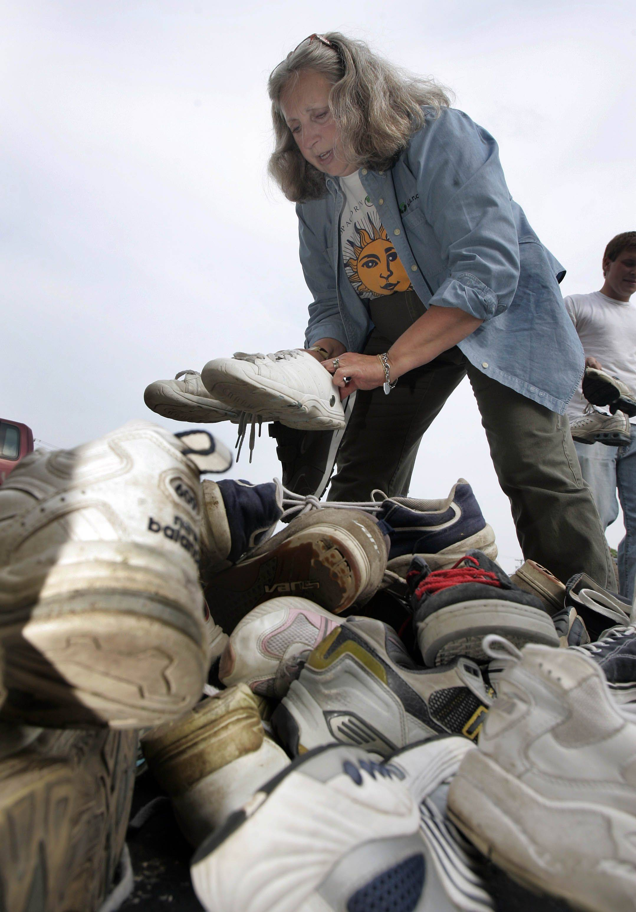 Kay McKeen sorts through donated gym shoes that are recycled or donated to people all over the world.