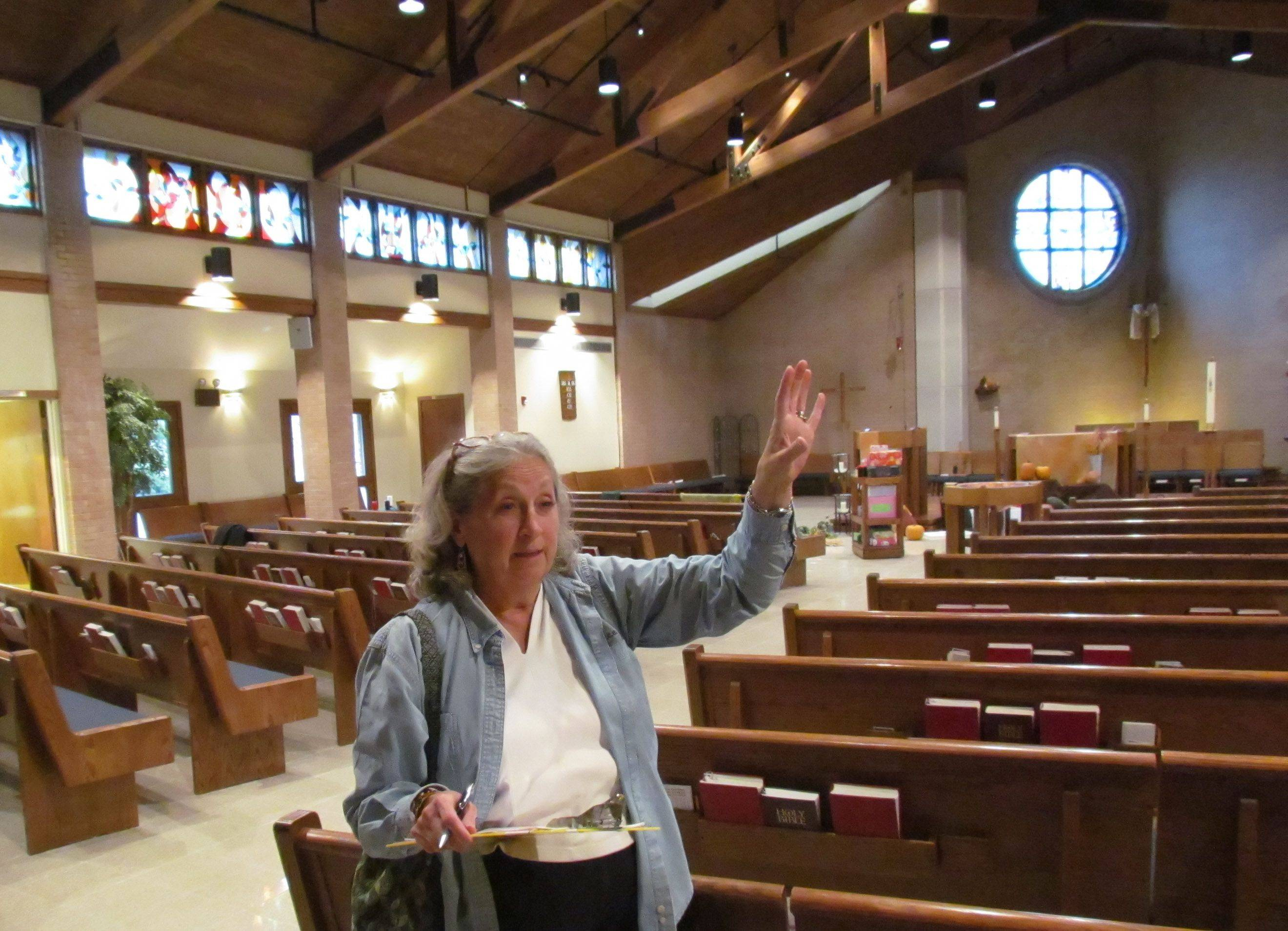 "Kay McKeen conducts a ""green audit"" of St. Timothy Lutheran Church in Naperville. She examines energy uses and makes recommendations to representatives of the church."