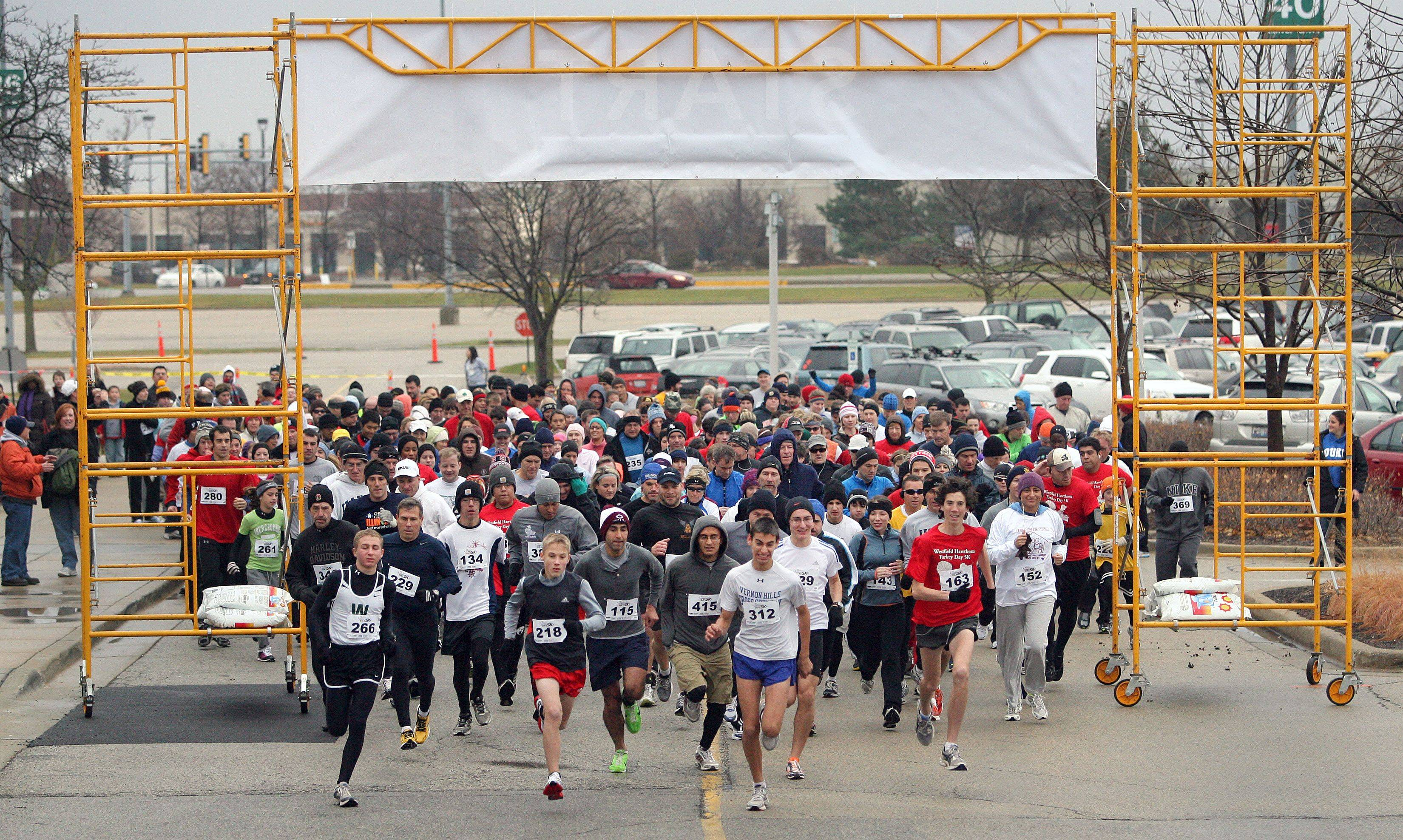 Runners dash at the start of the Second Annual Westfield Hawthorn Turkey Day 5k run at Wesfield Hawthorn Mall in Vernon Hills Thursday morning.