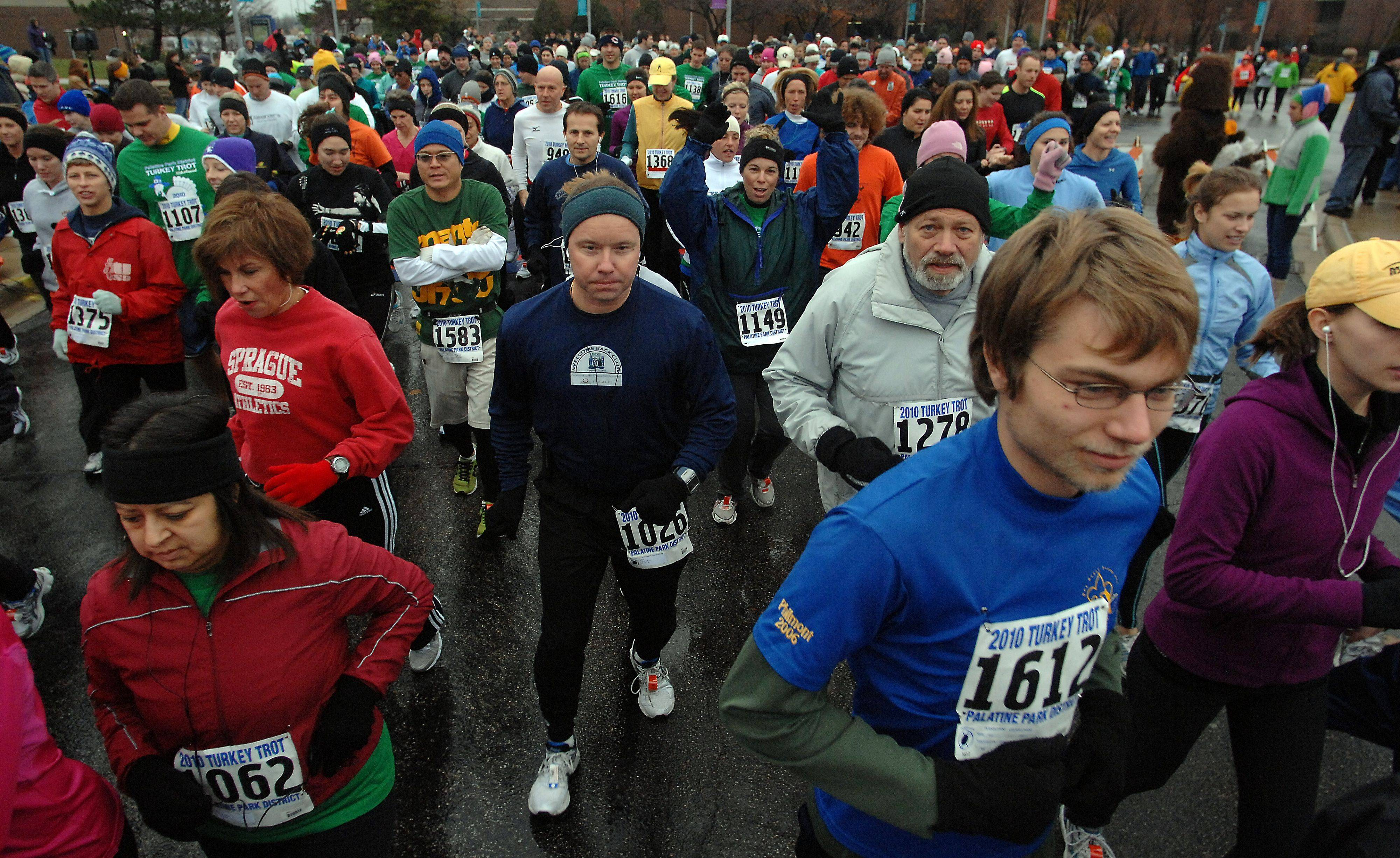 Runners start the Turkey Trot five-mile course at the 30th annual Thanksgiving Day Turkey Trot held on the William Rainey Harper College campus in Palatine.