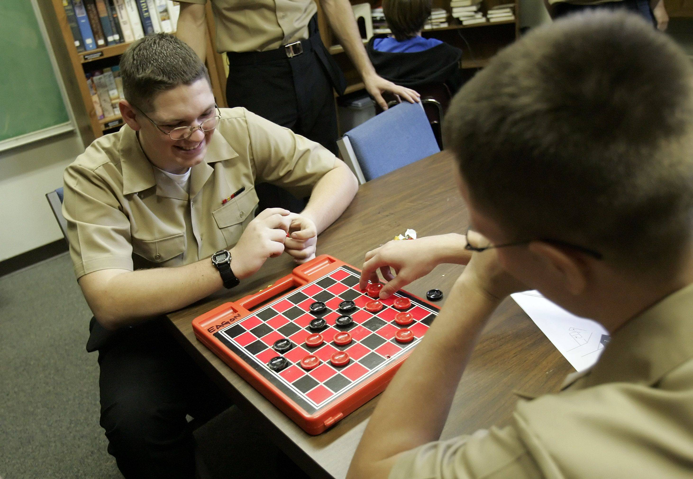 Brian Henslee of Covington, Ohio, left, and Loren Mams New Smyrna, Florida play checkers at Gurnee Community Church.