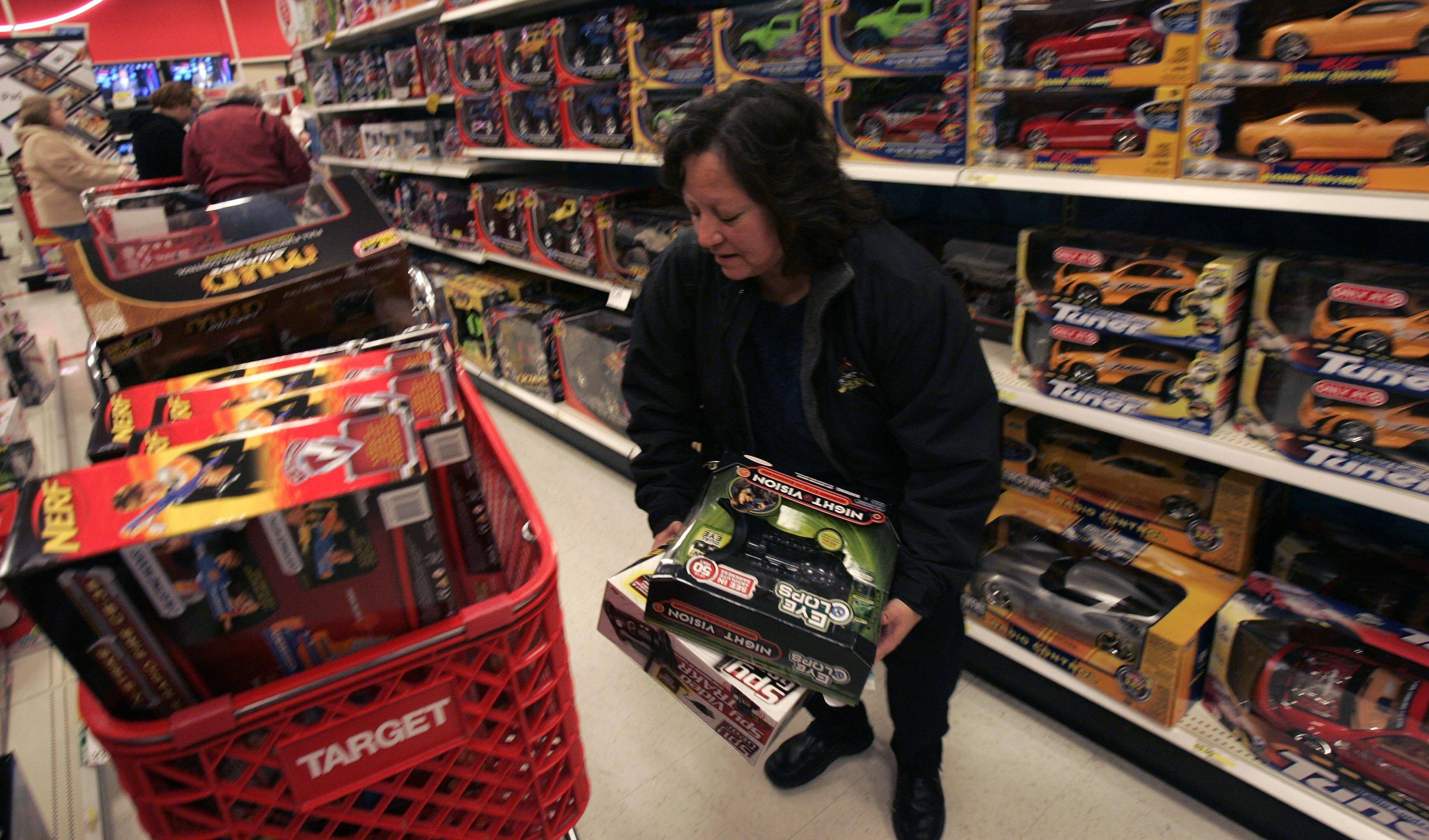 Lori Anne Pettey of Wayne fills up her cart with gifts at Target in South Elgin during Friday.