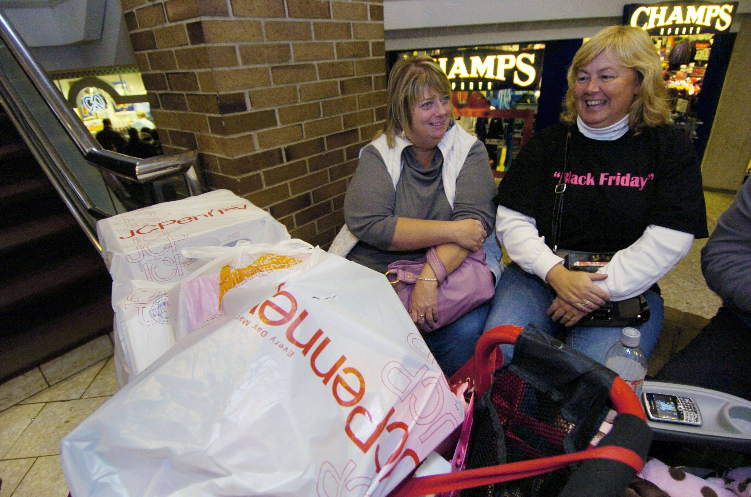 Patty McElroy of Chicago, left, and Mary Nessling of Rosemont take a break while shopping on black Friday at Woodfield mall.
