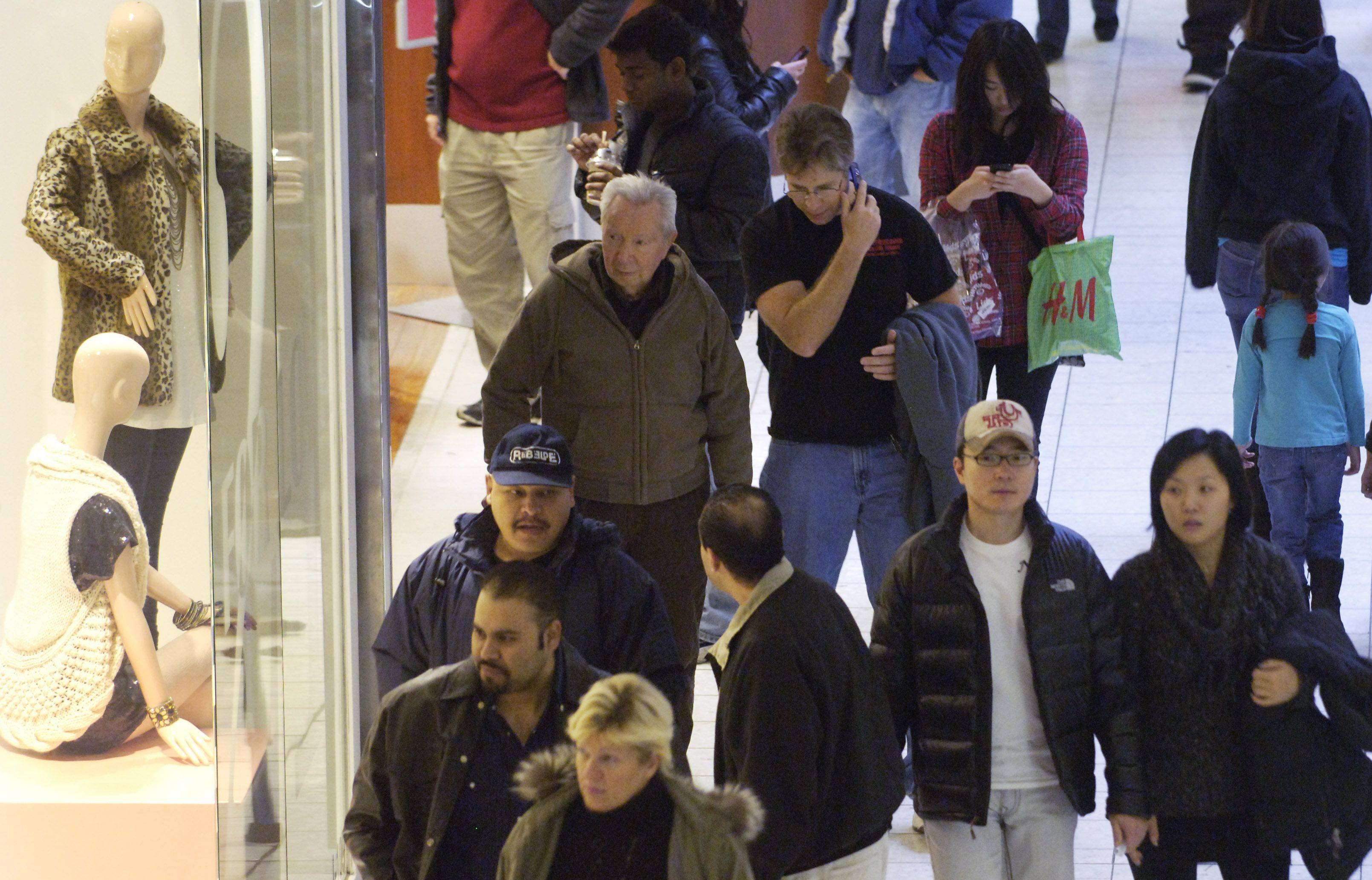 Shoppers crowd Woodfield mall Friday.