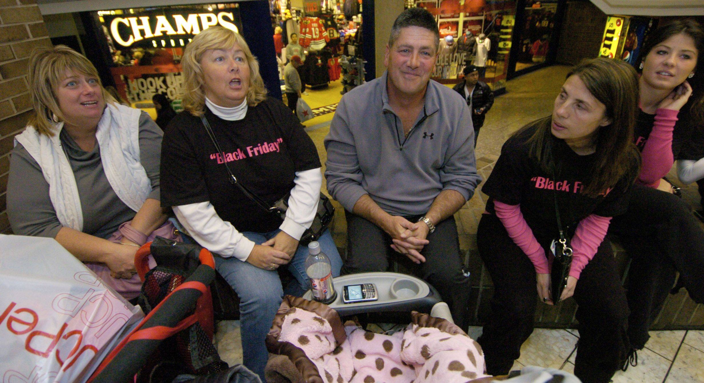Patty McElroy of Chicago, from left, Mary Nessling of Rosemont, Bill Isabell and Stephanie Otte of Northlake during Black Friday's shopping in Schaumburg.