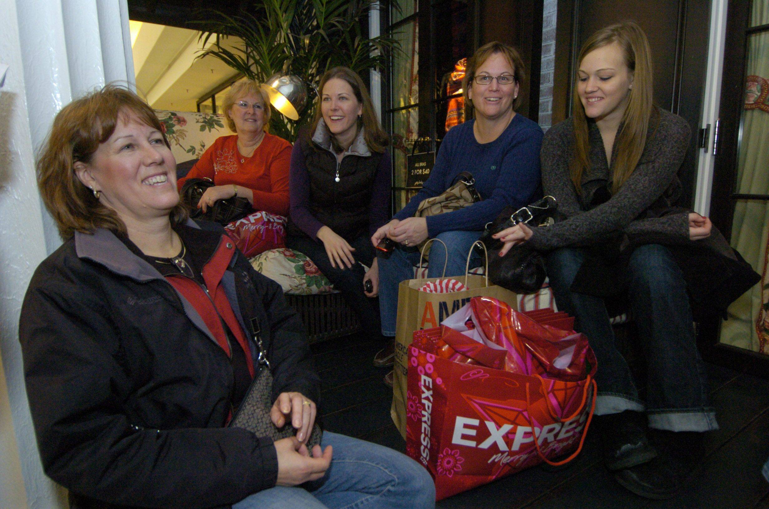 Sue Black of Arlington Heights, from left, Sharon Kilcoyne of Gurnee, Kristen Black-England of Chicago, Sheryl Wiegel of Gurnee, and Kim black of Arlington Heights take a break from shopping at Woodfield mall.