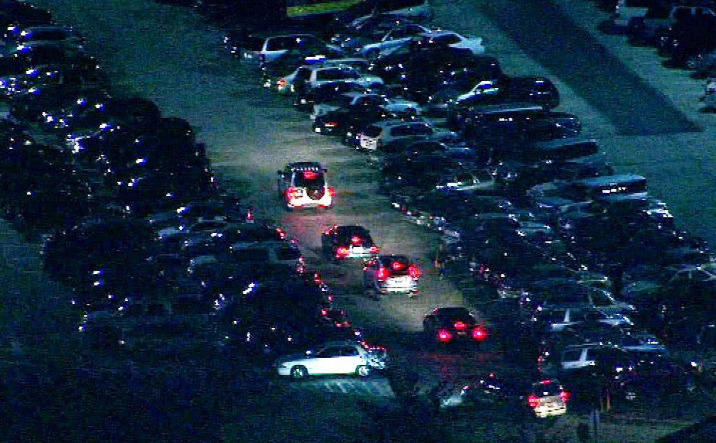 Shoppers look for parking spaces as well as bargains in the early hours at Woodfield Mall in Schaumburg Friday.
