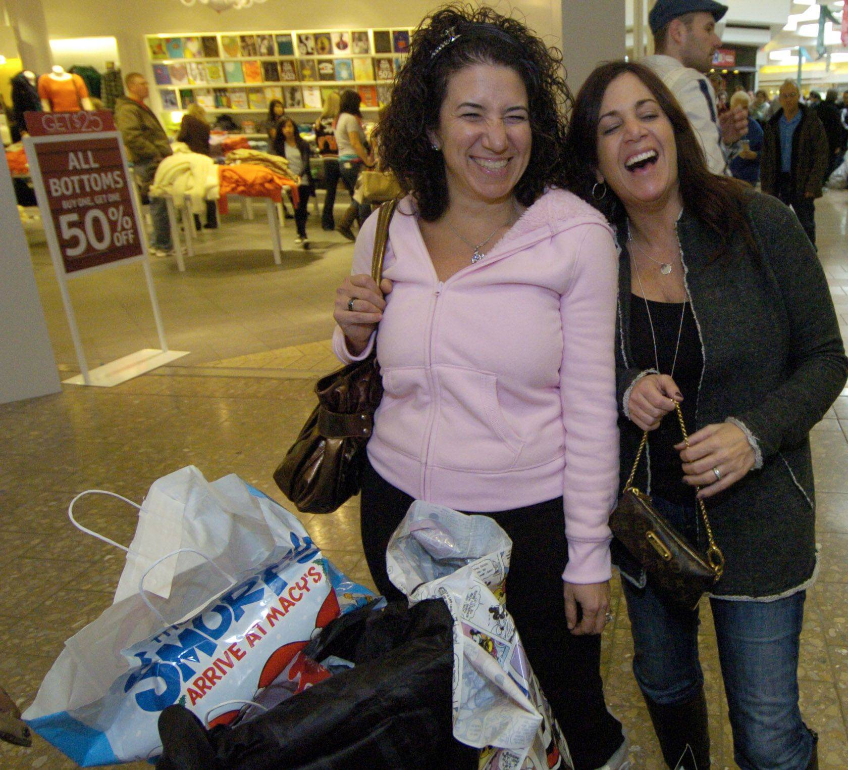 Donna Collins, left, of Lake in the Hills and Julie Mertz of Algonquin talk about shopping on Black Friday at Woodfield mall in Schaumburg.