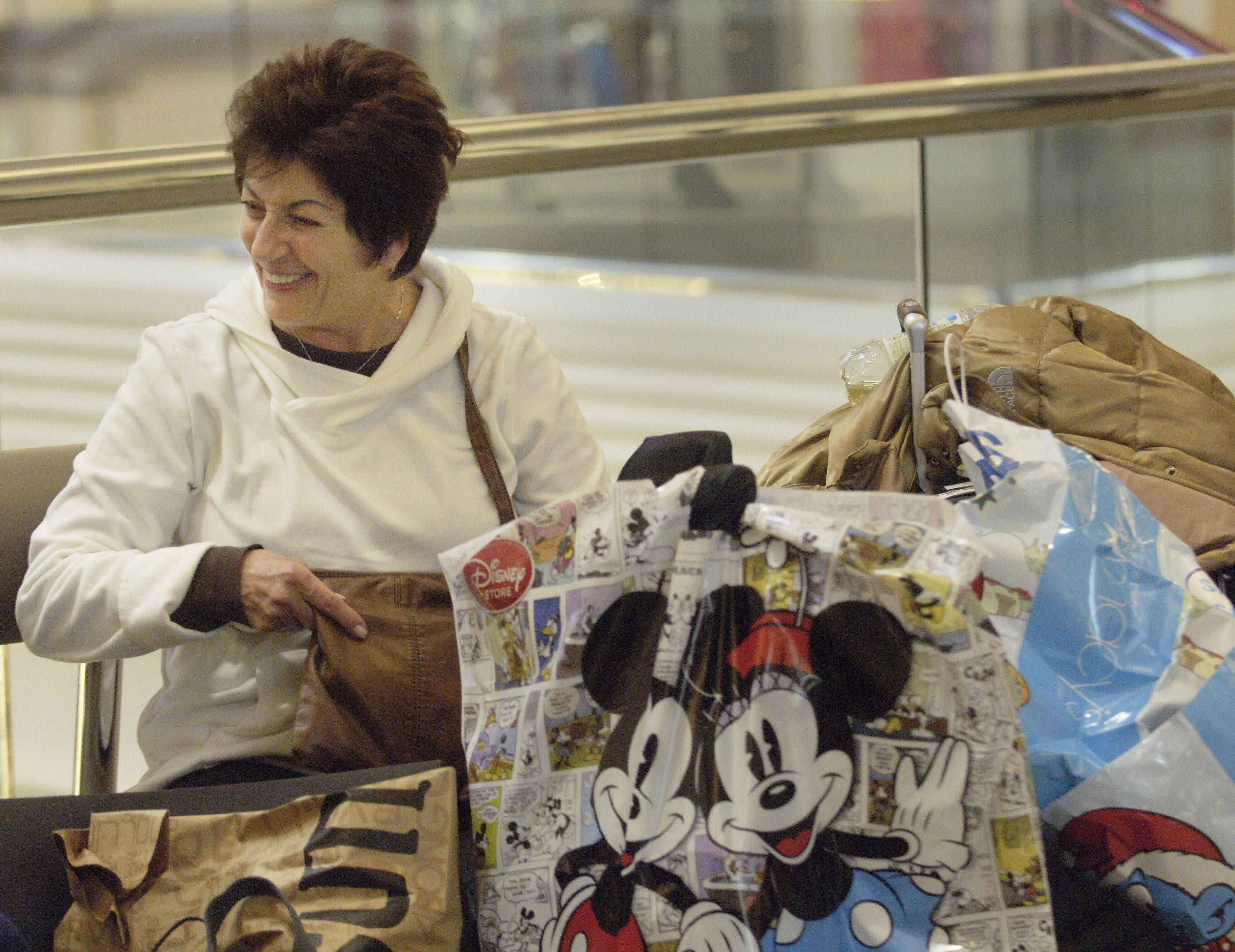 Fran Divizio of Schaumburg takes a break while shopping at Woodfield mall in Schaumburg Friday.