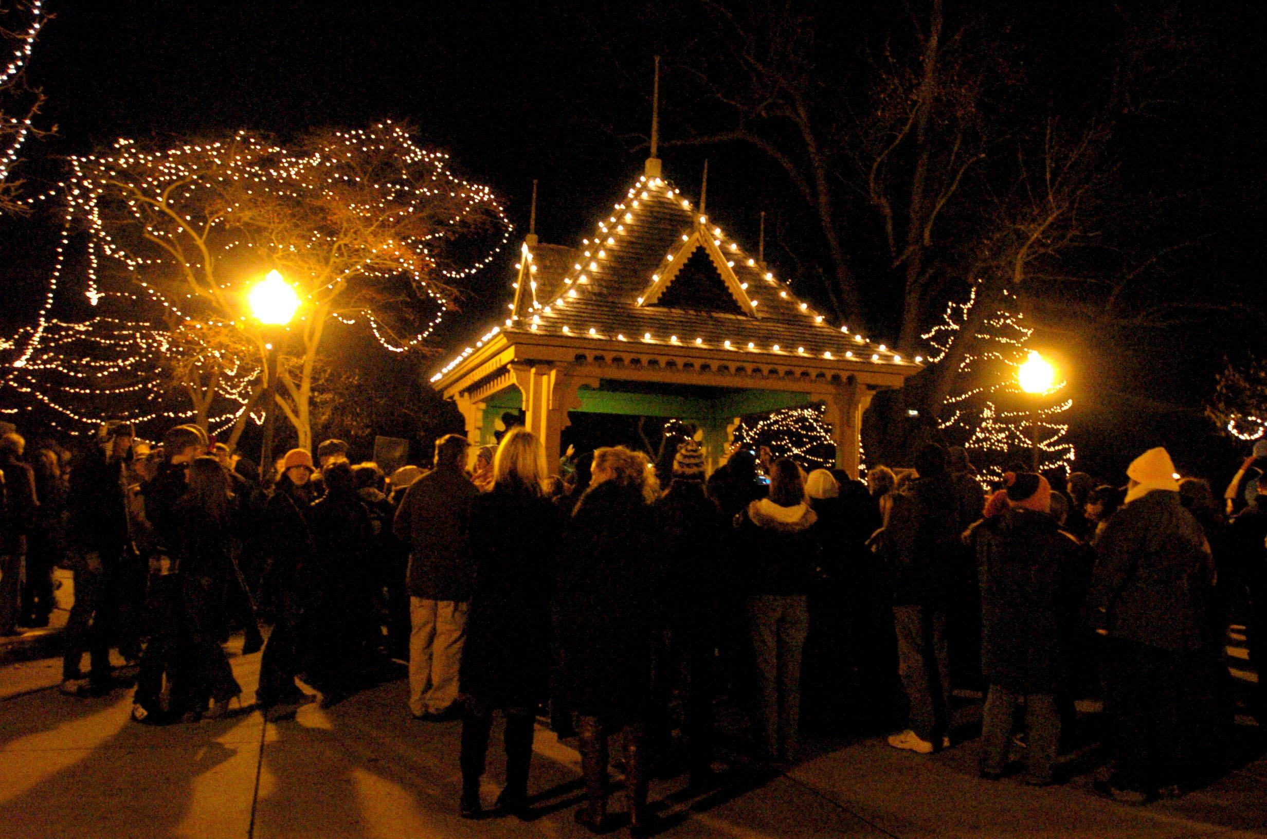 A crowd gathers for the lighting of the holiday lights at Lincoln Park in St. Charles Friday night.