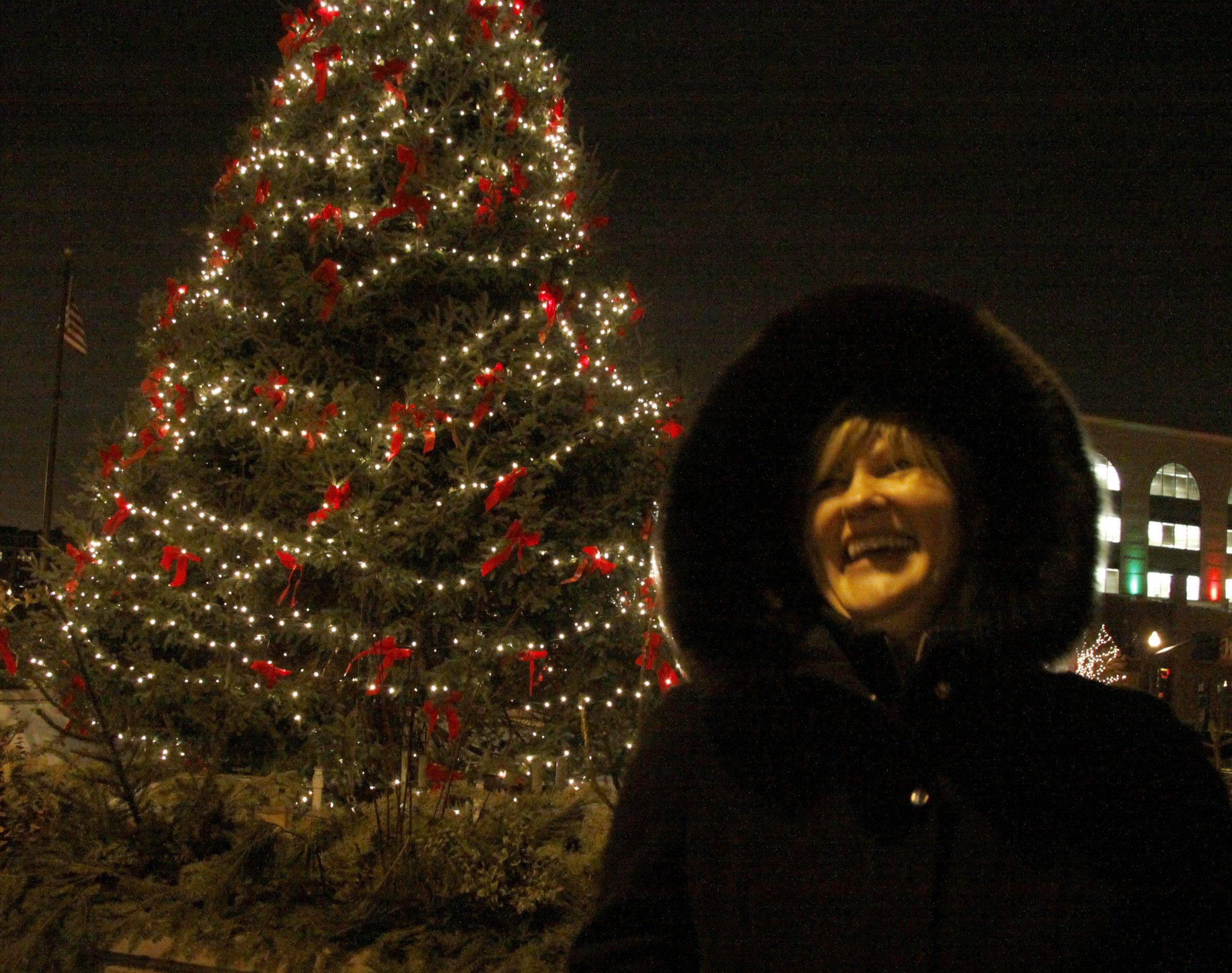"Julie Reinhardt, Downtown Wheaton Association's Volunteer of the Year, kicked off the ""Dickens of a Christmas"" celebration in Wheaton off by lighting the tree at Martin Plaza Friday."