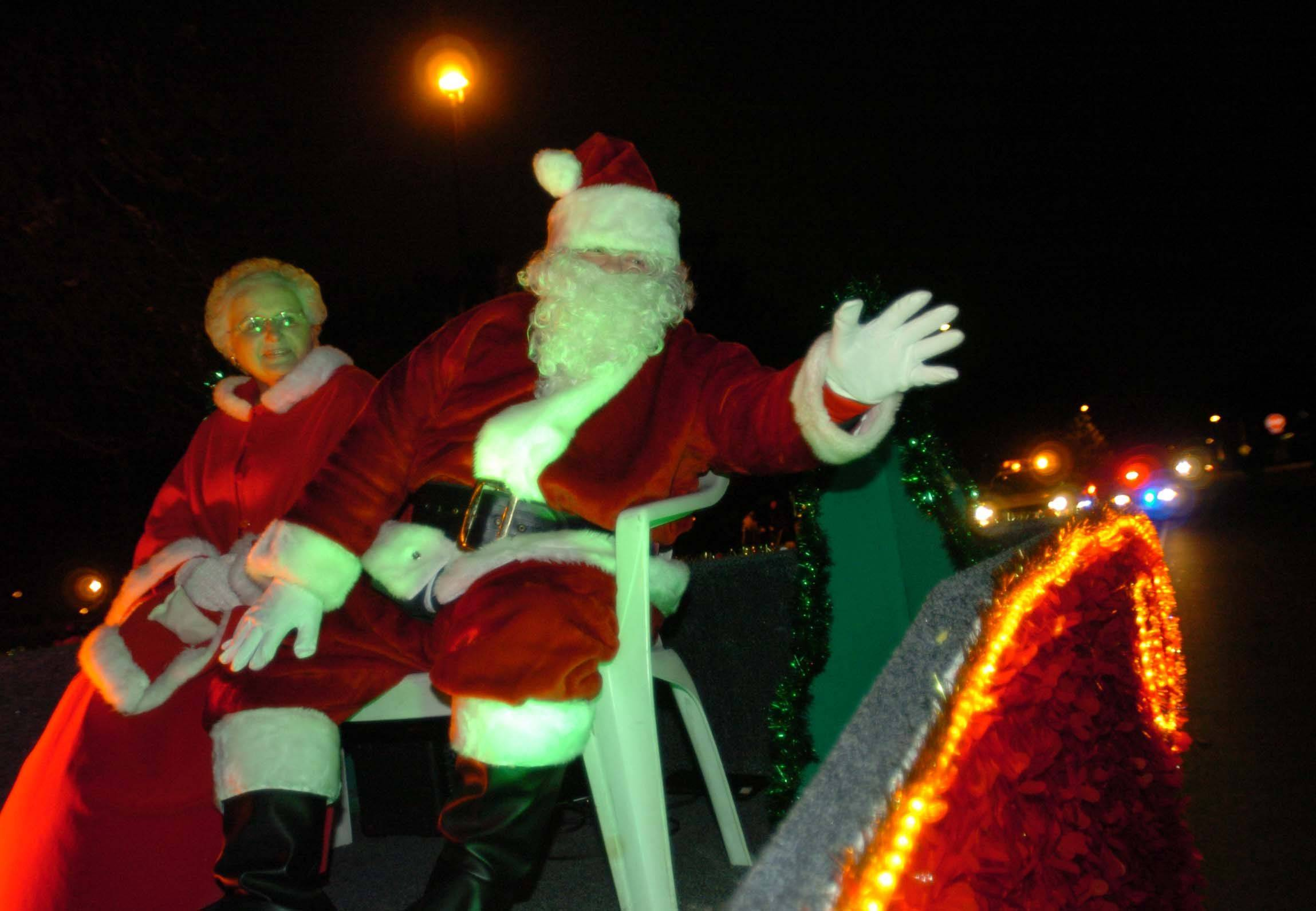 Santa and Mrs. Claus wave during the parade at Naperville's Hometown Holidays celebration Friday. Well over 500 people took part in the event.