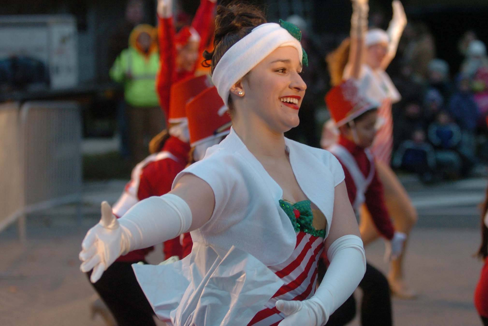 Devon Lloyd of Naperville takes part in Naperville's Hometown Holidays celebration Friday.