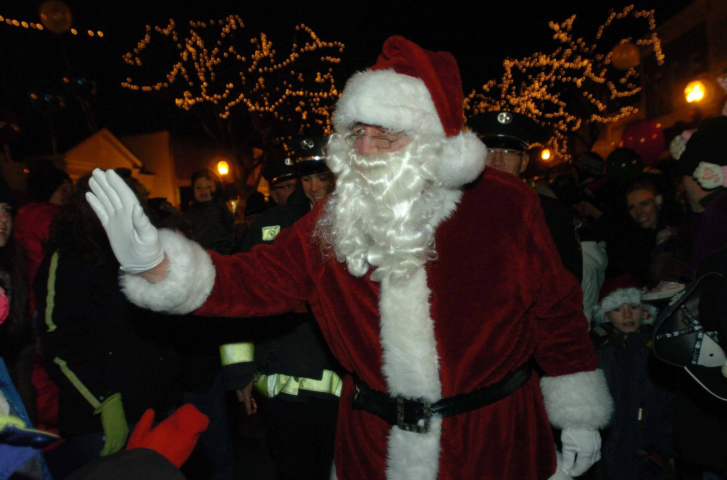 Santa waves to a crowd gathered for the Glen Ellyn Tree lighting Friday.