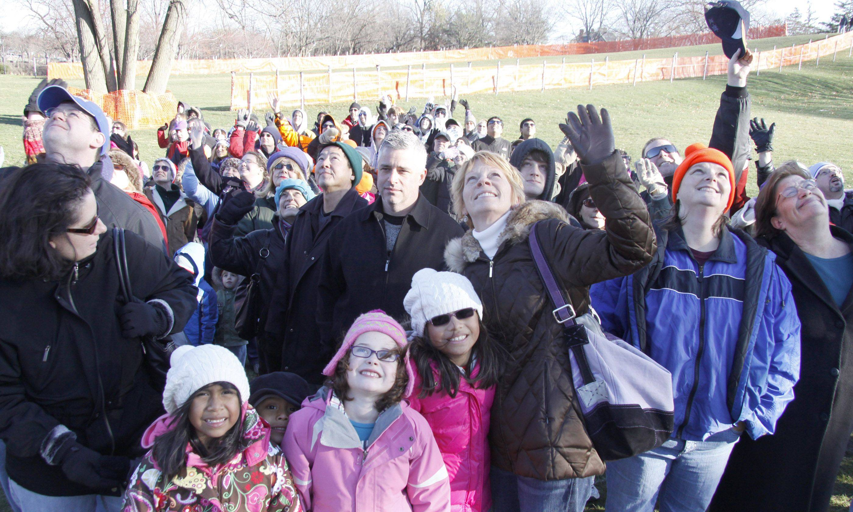 "Residents of Naperville assemble at Rotary Hill to spell out the word ""Peace"" in a town group picture Friday."