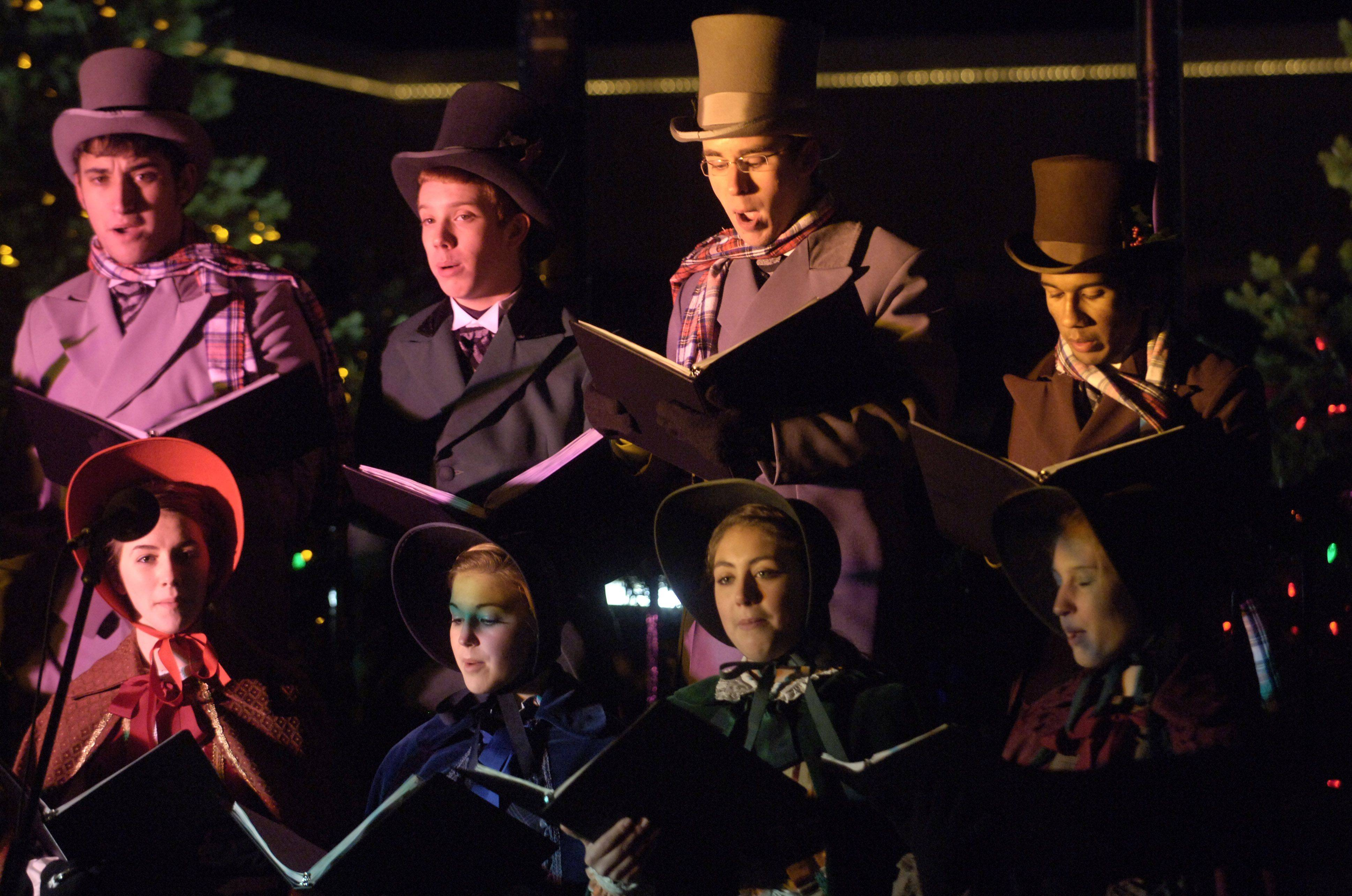 The John Hersey High School Dickens Carolers sing during the Arlington Heights tree lighting at North School Park Friday.