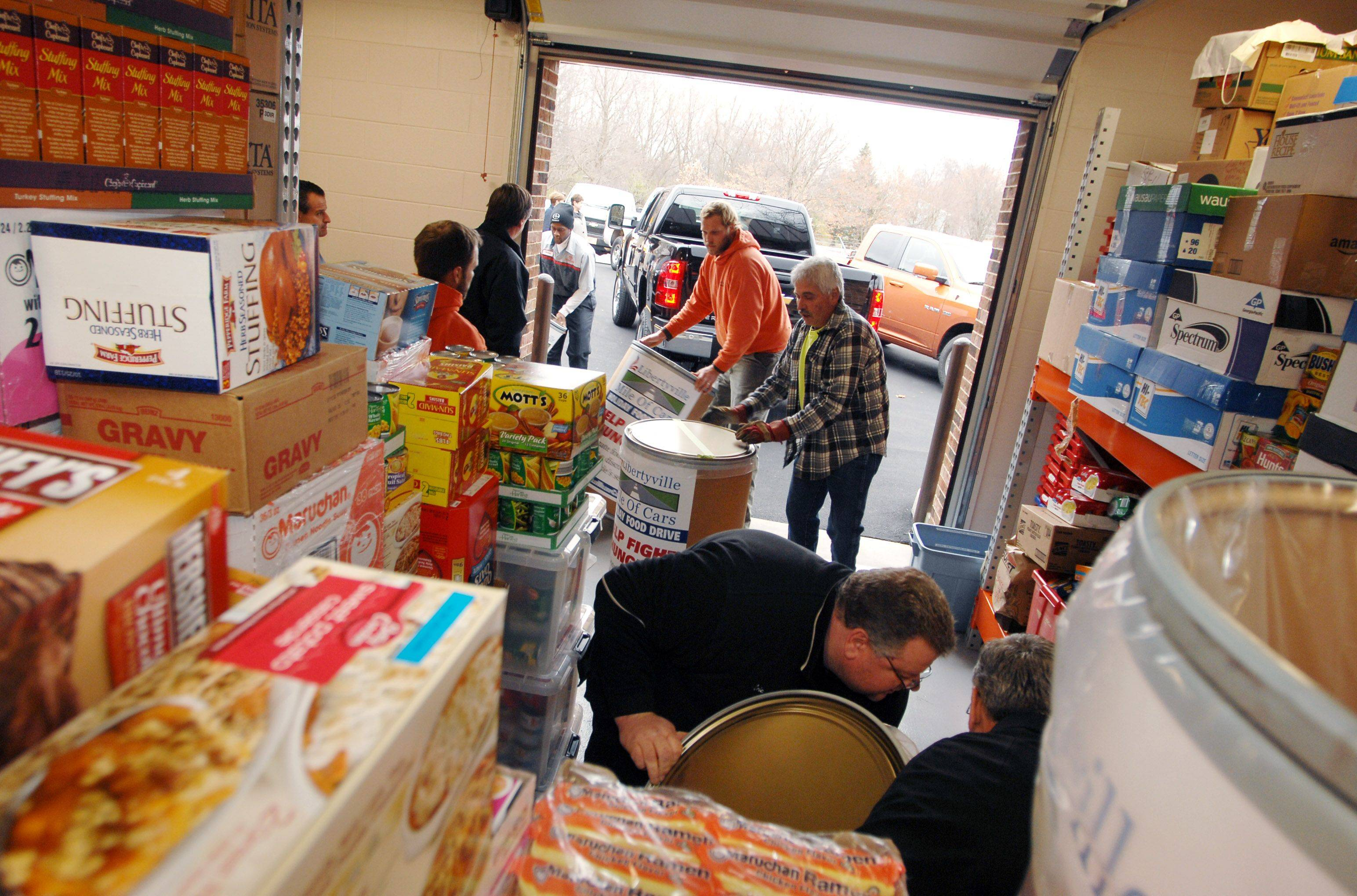 PAUL VALADE/pvalade@dailyherald.com The Libertyville Township Food Pantry received food this week from a pair of local food drives. Township officials say they have enough goods for the winter, but other township pantries say they're struggling to keep up with demand.