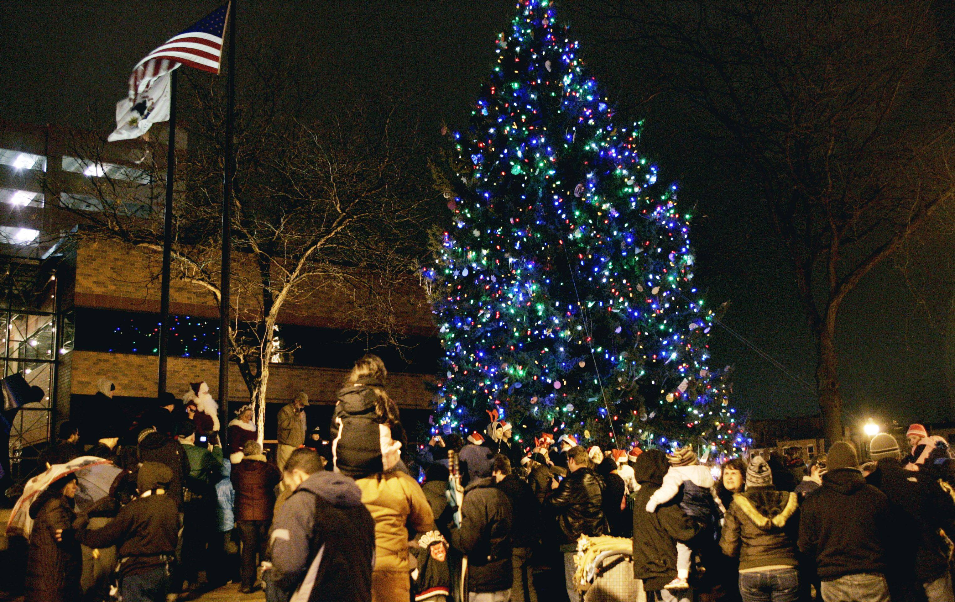 More than 60 residents joined with city of Aurora as the Christmas tree was lit Wednesday night at North Island Center in downtown Aurora.