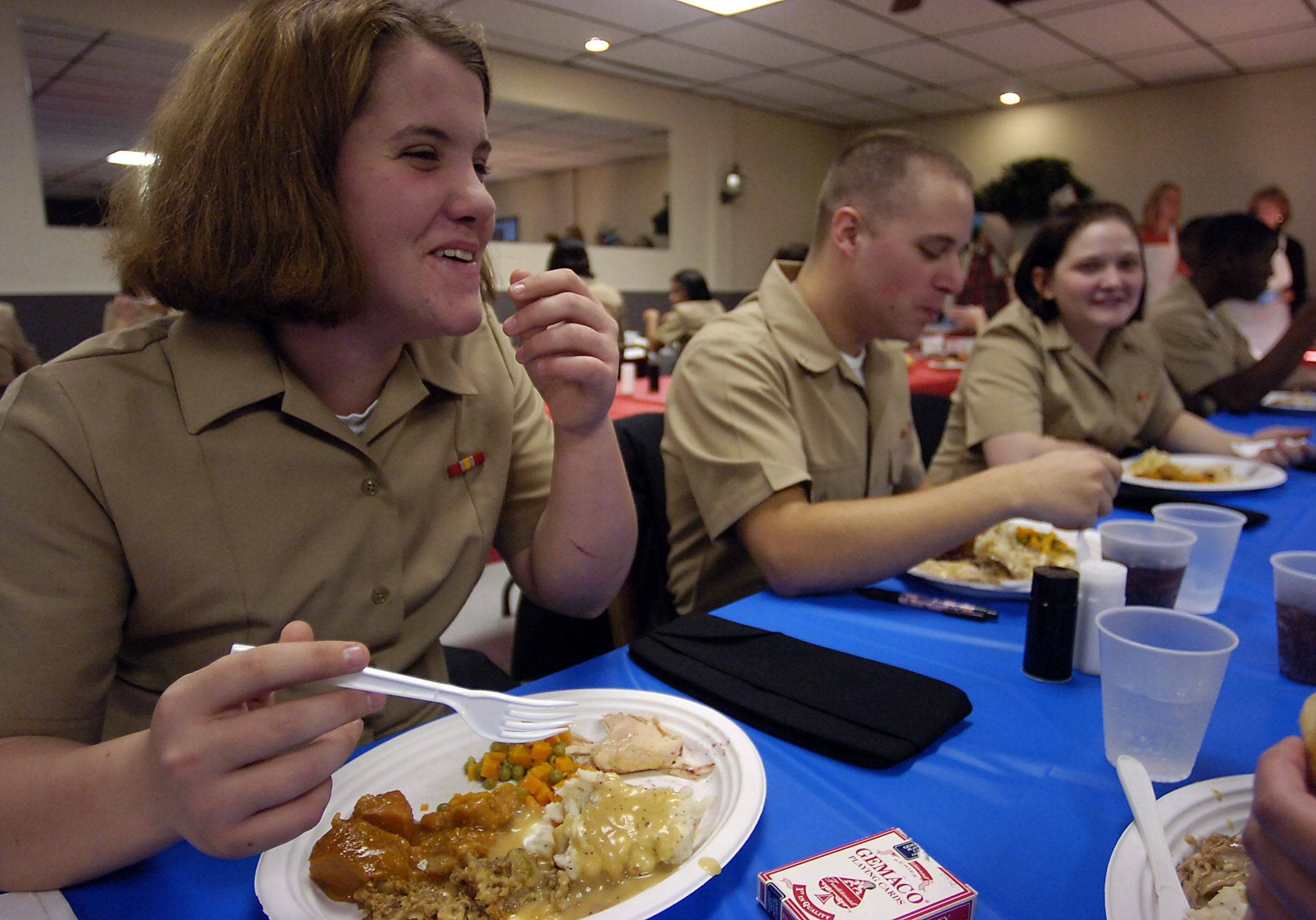 Seaman Recruit Nicole Southard, 18, of Portland, Maine eats with her fellow recruits at Amvets Post 66 in Wheeling for their Thanksgiving holiday.