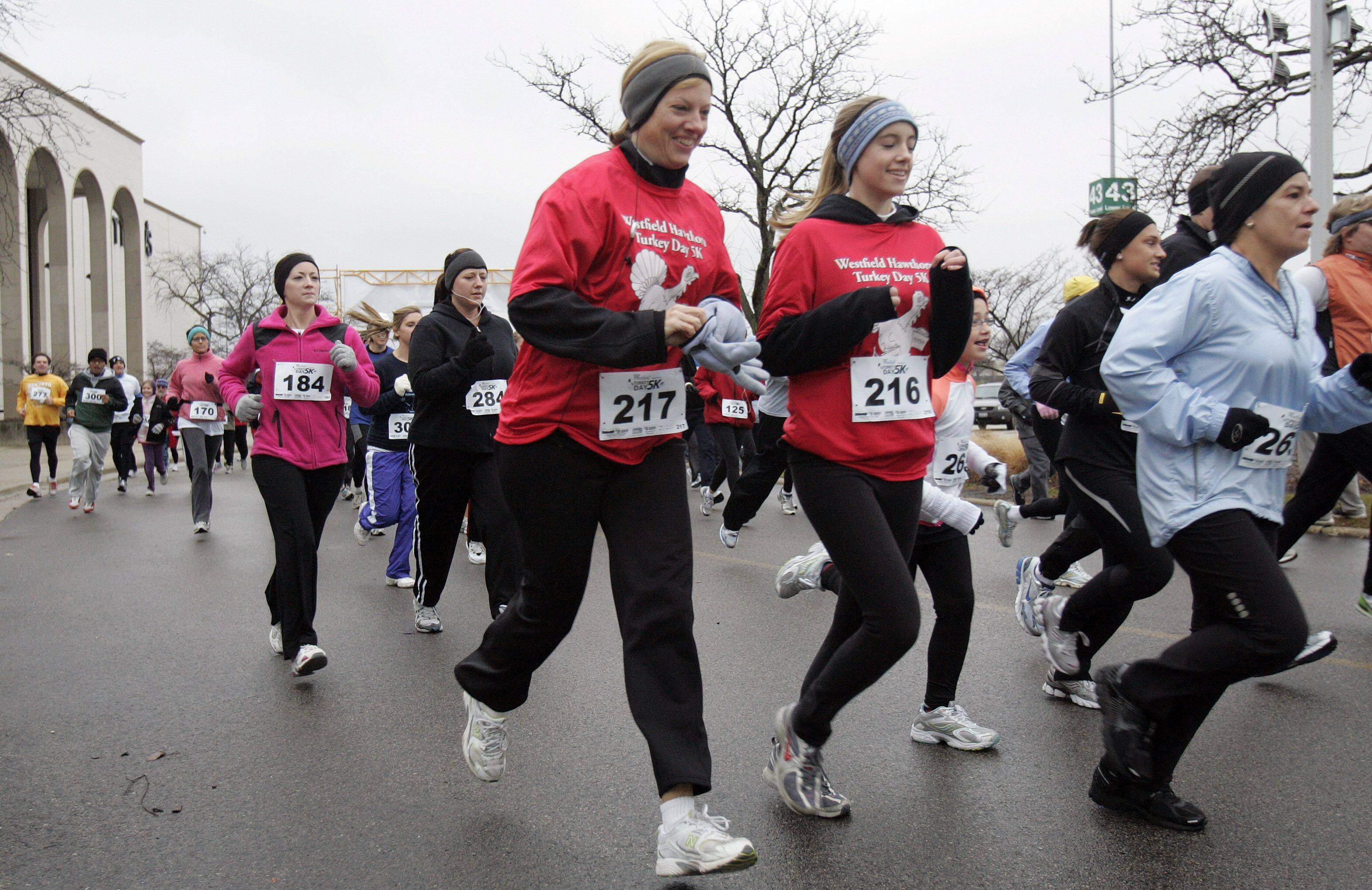 People participate in the 2n-Annual Westfield Hawthorn Turkey Day 5k at Wesfield Hawthorn Mall in Vernon Hills Thursday morning. A portion of the proceeds went to benefit Arden Shore Child & Family Services for Lake County children and families.