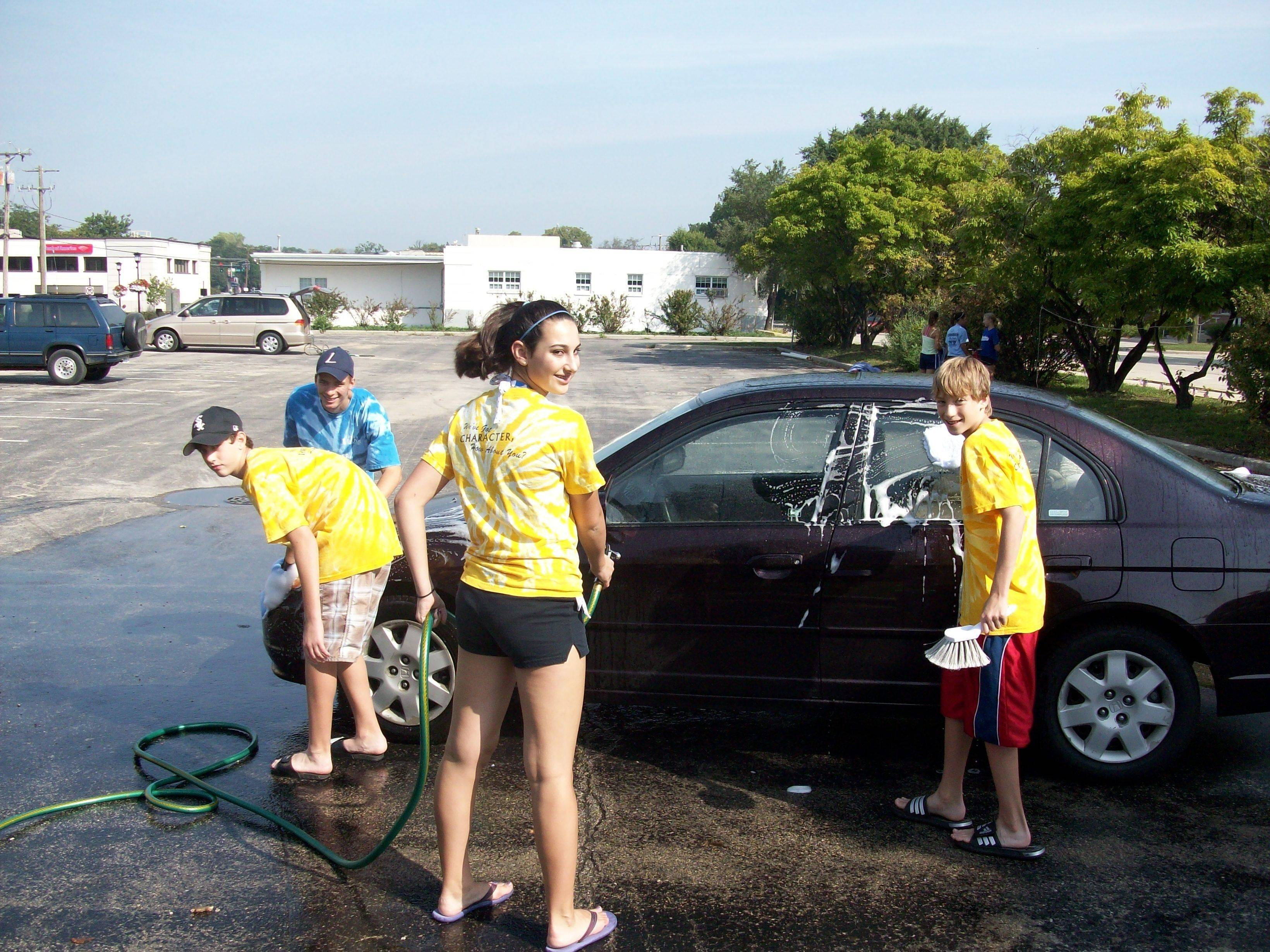 Members of Lisle Teens With Character work at their Sept. 11 Memorial Car Wash.