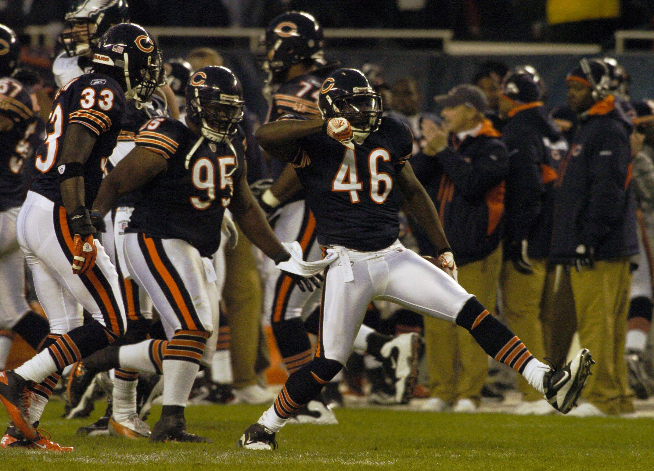 Bears safety Chris Harris (46) celebrates after intercepting a pass by Michael Vick during the second quarter Sunday at Soldier Field.