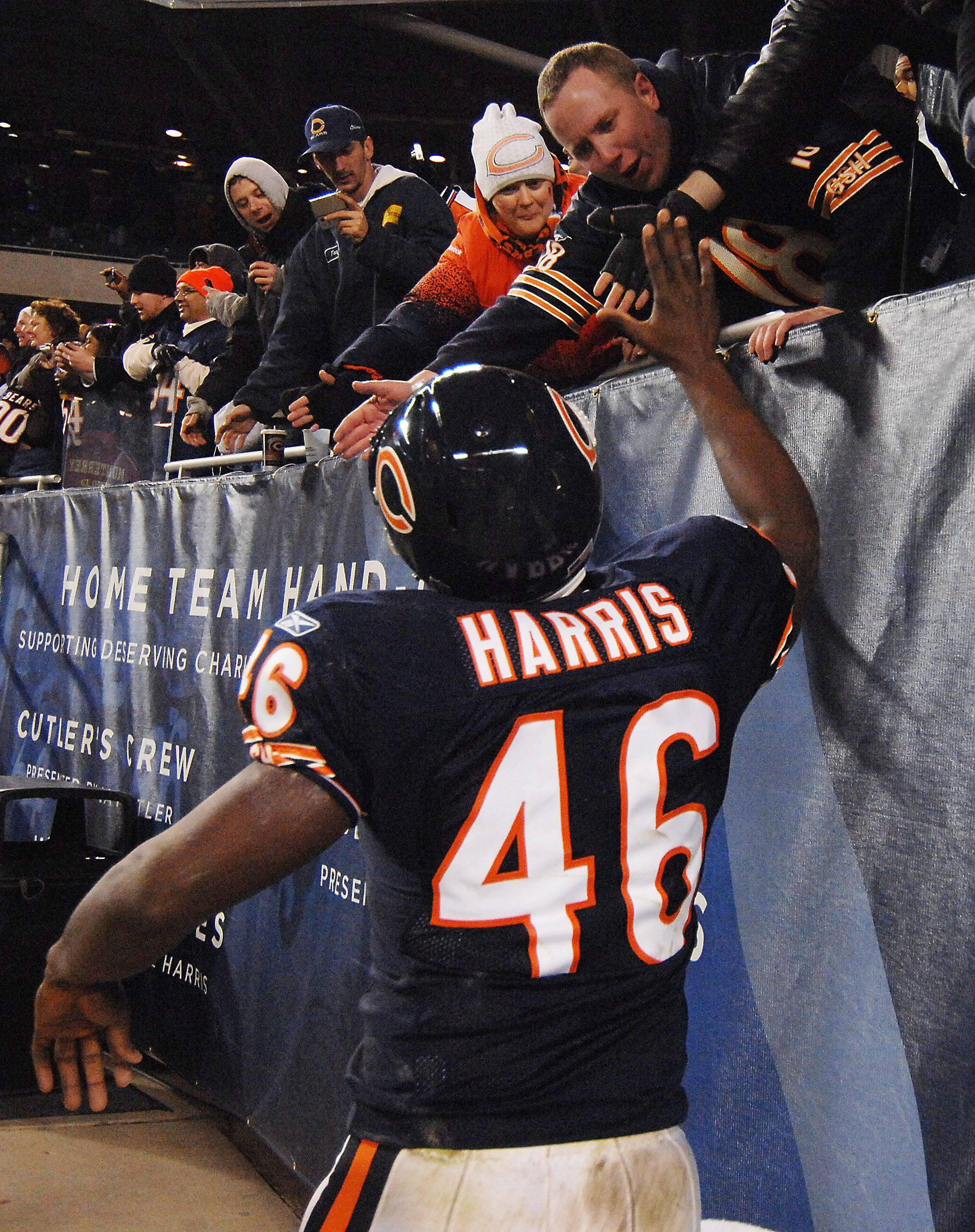Bears Chris Harris celebrates their victory with the fans at the end of the game against the Eagles.