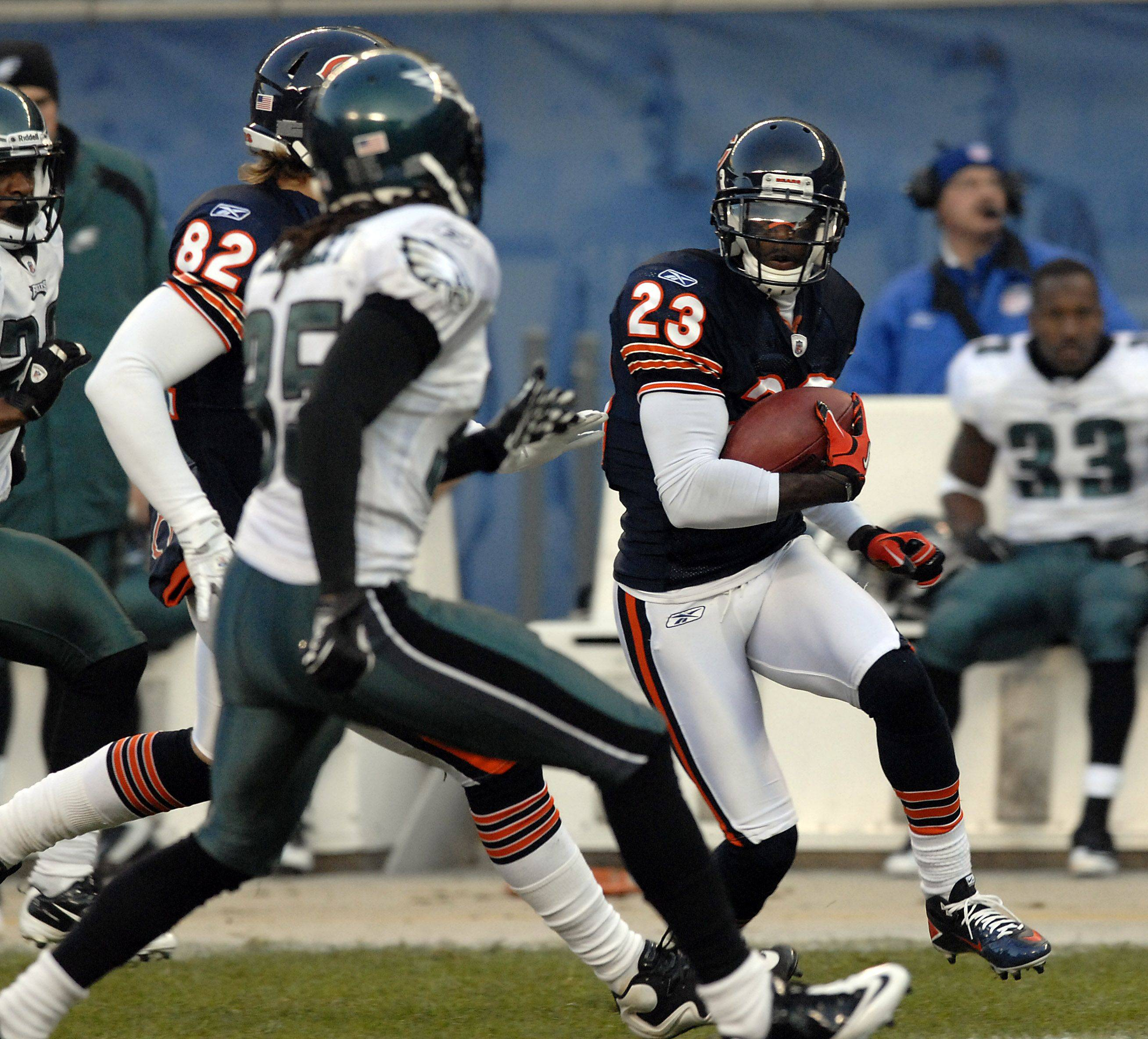 Bears Devin Hester on the move for yardage on his kick off return in the first half.