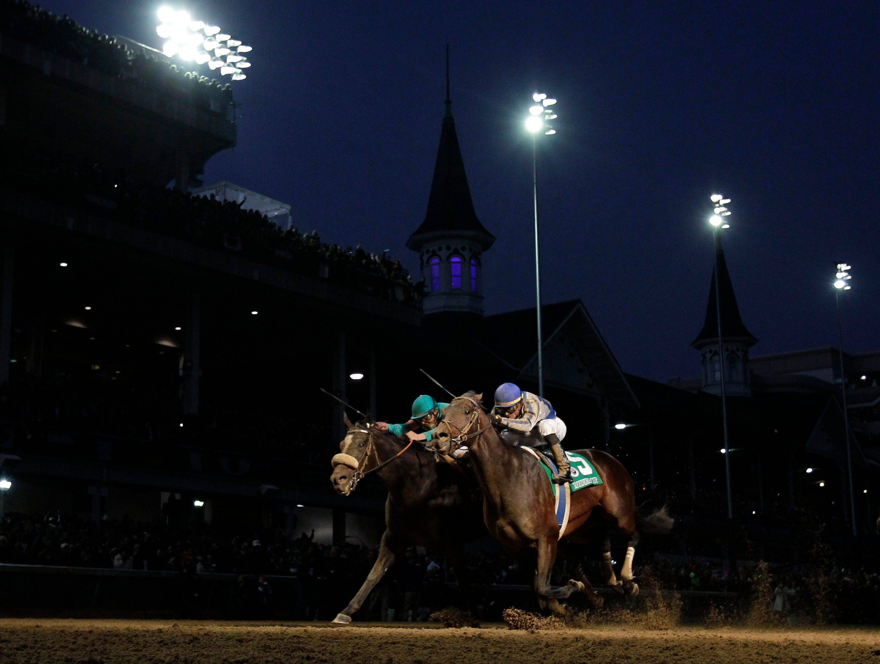 Garrett Gomez, right, rides Blame to victory during the Classic race at the Breeder's Cup horse races at Churchill Downs on Nov. 6. Mike Smith, riding Zenyatta, finished second.