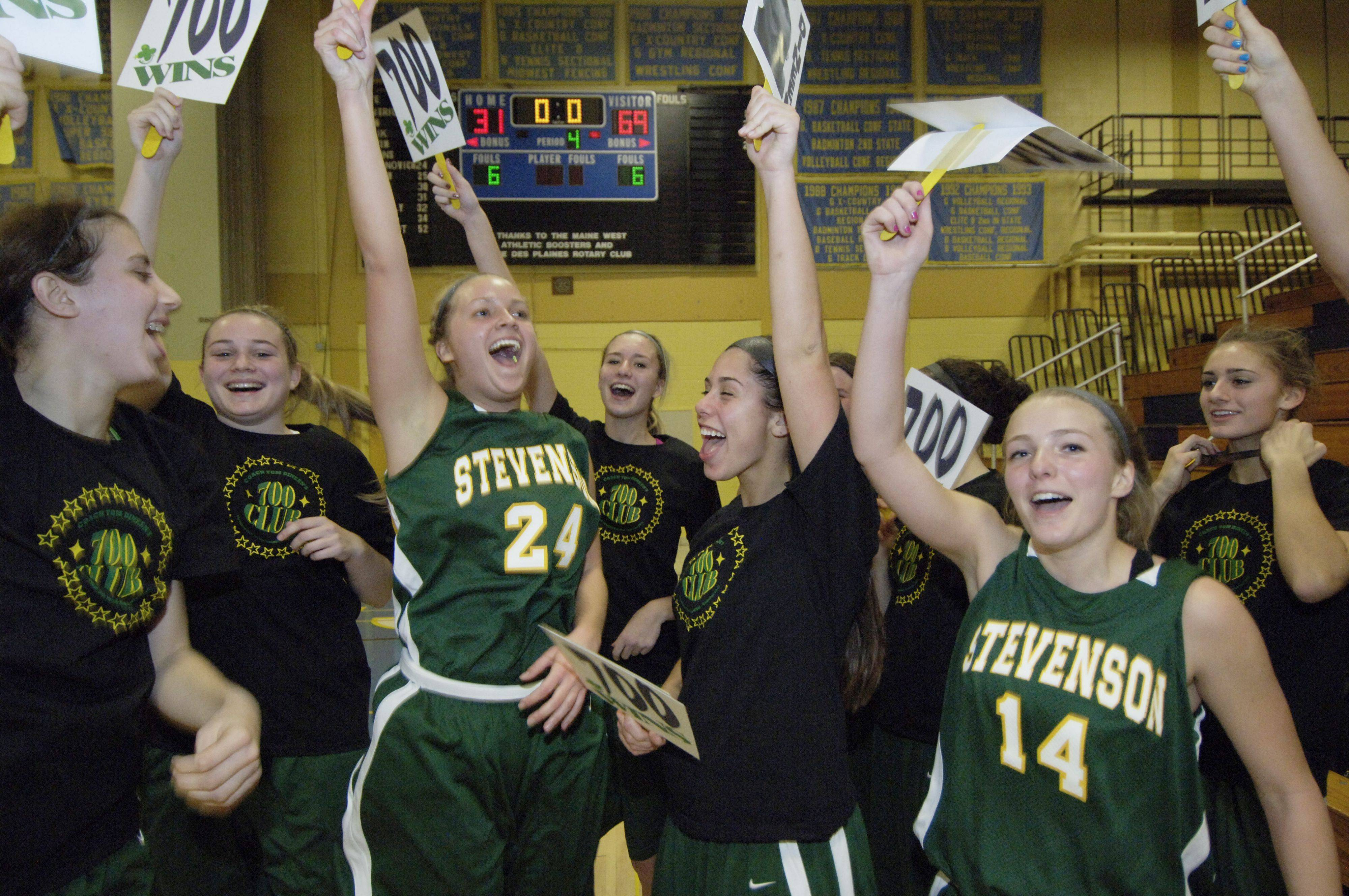 The Stevenson girls basketball team celebrates as their coach, Tom Dineen, reached 700 career wins defeating Maine West Wednesday.