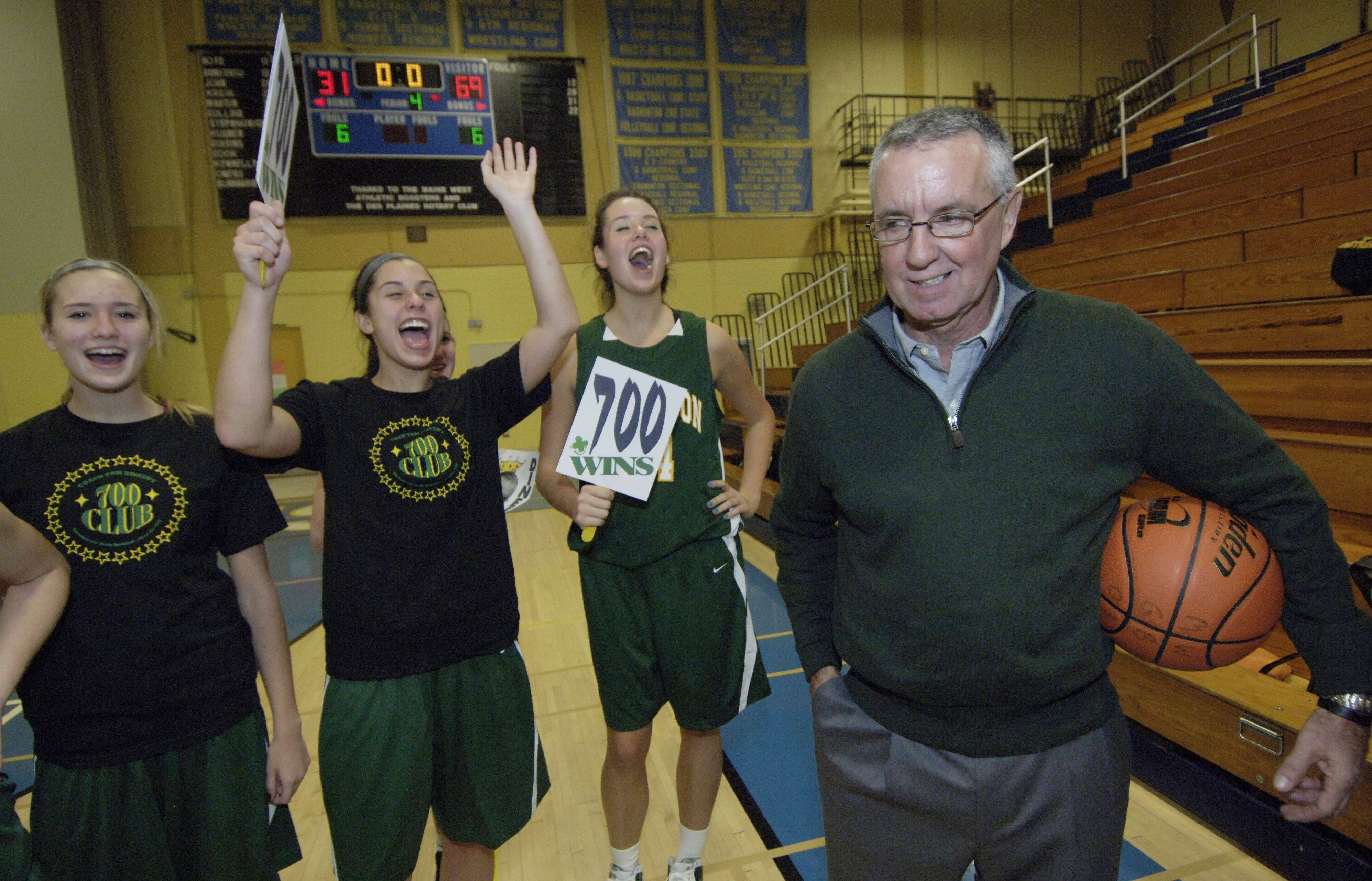 Stevenson girls basketball coach Tom Dineen celebrates his 700 career wins with his team after defeating Maine West Wednesday.