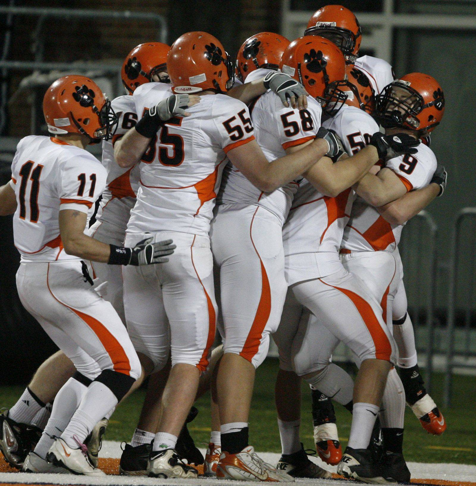 Wheaton Warrenville South celebrates a touchdown against Lake Zurich in the 7A state title game in Champaign on Saturday, November 27.