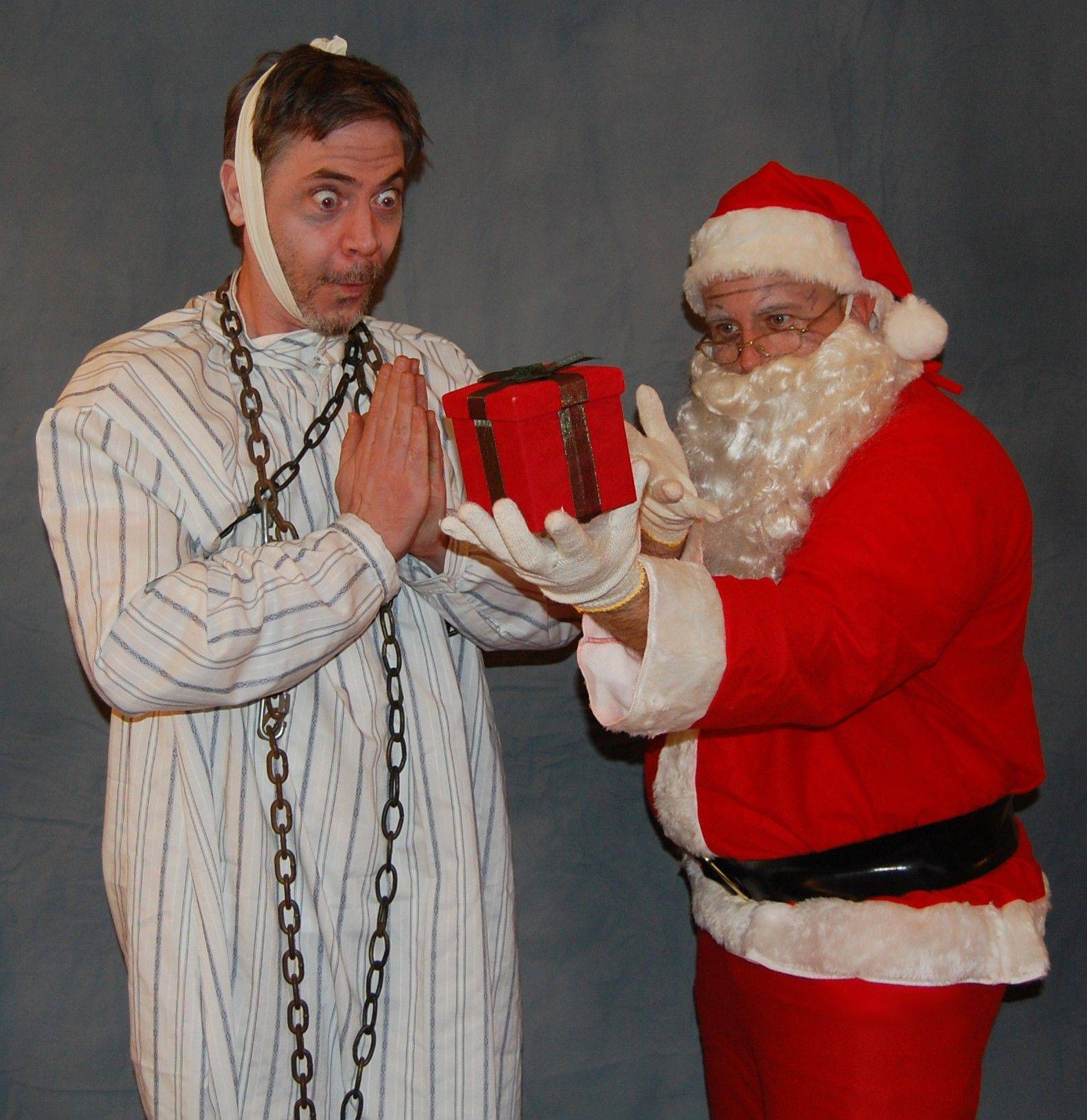 "Geoffrey Maher, left, plays the ghost of Jacob Marley and Marc Jolley plays Santa in ""Marley's Ghost"" from the Palatine-based Vex Theatre Company. The show is part of the company's ""Twist-a-Carol"" production in Elgin."