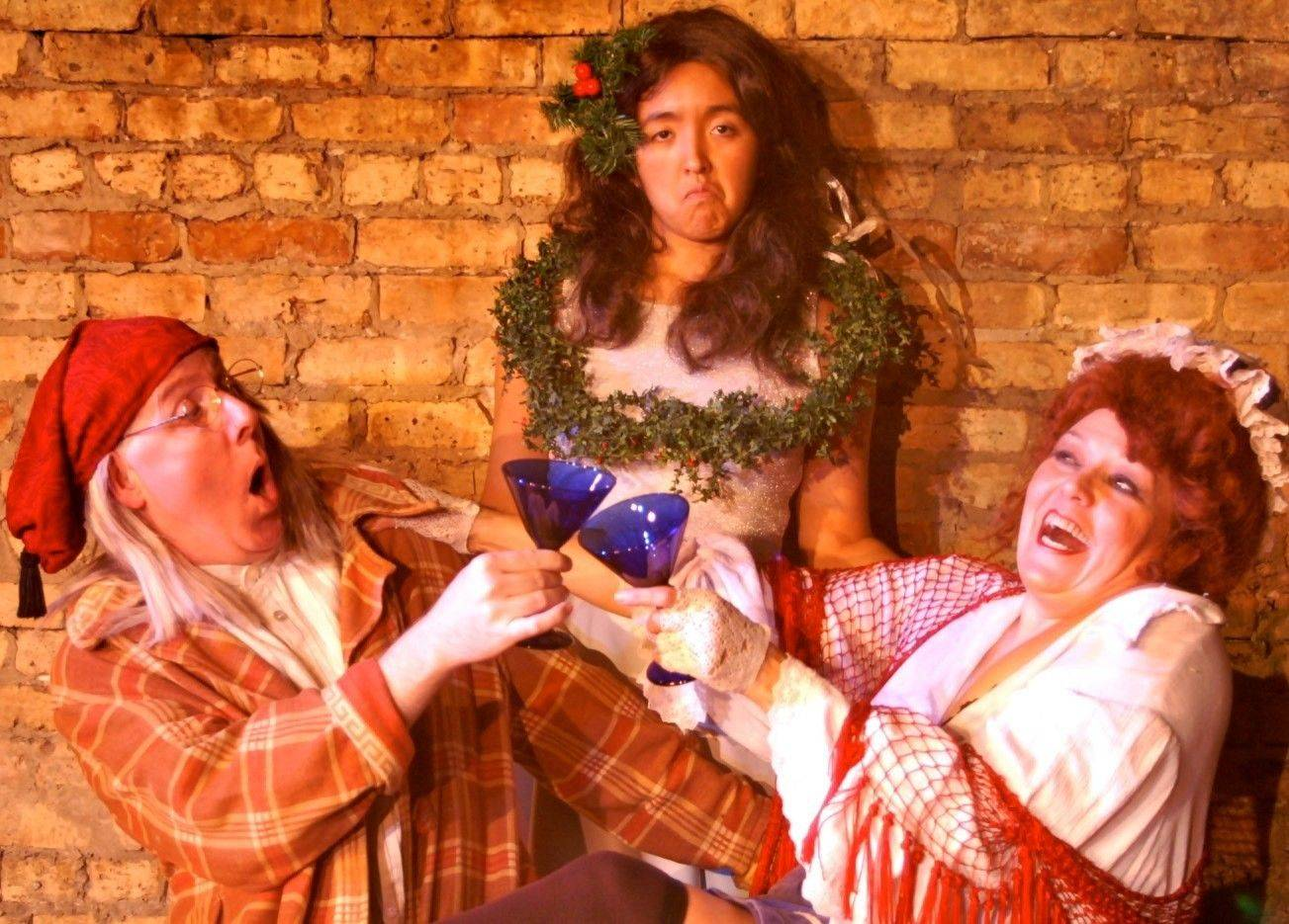 "Steve Hickson, left, Samantha Garcia and Tina Haglund star in ""Mrs. Bob Cratchit's Wild Binge,"" a holiday satire based on characters from ""A Christmas Carol,"" being staged by Chicago's A Reasonable Facsimile Theatre Company."