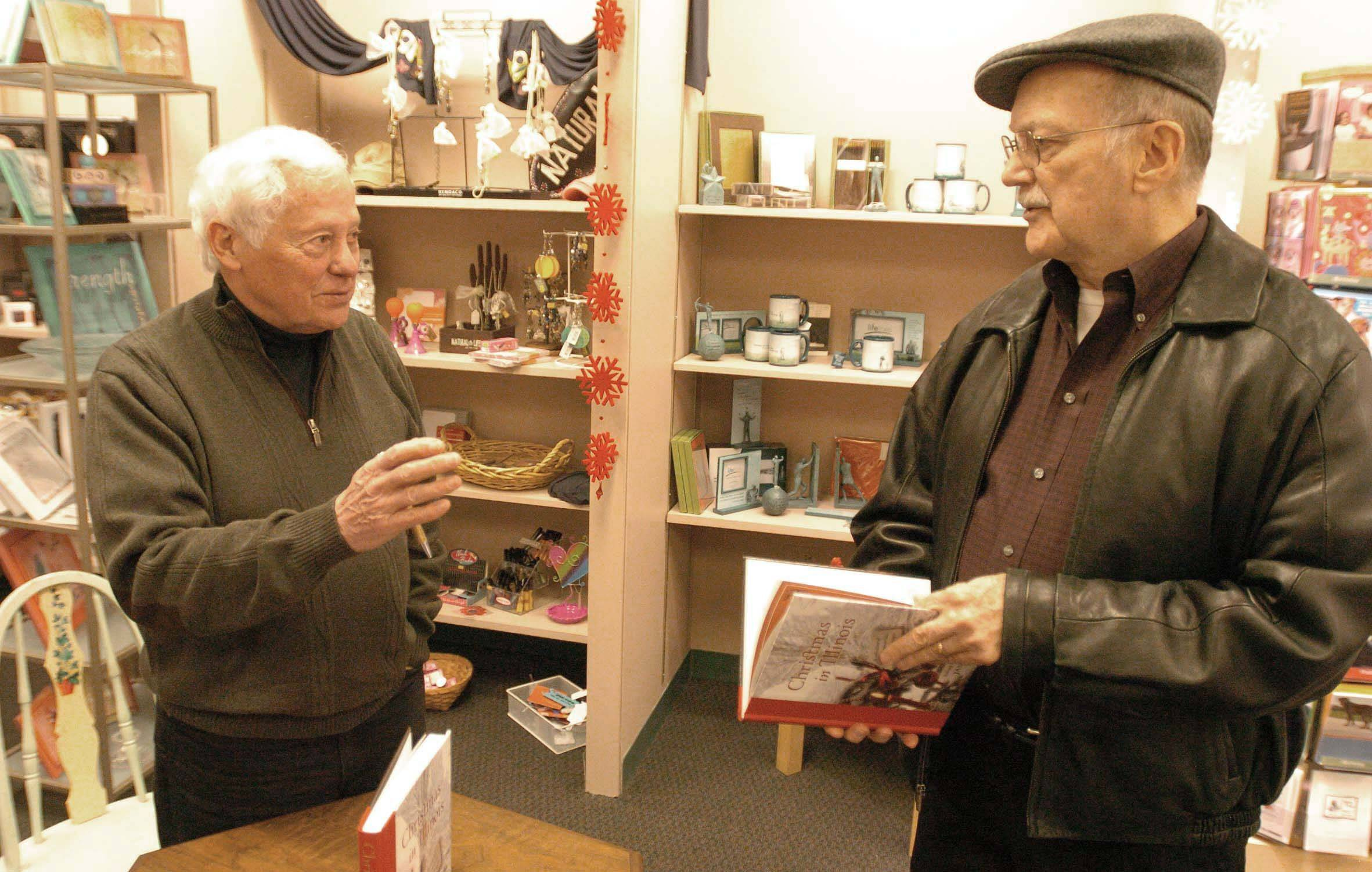 Author and editor James Ballowe, left, chats with Jack Lane during a recent book-signing at Anderson's Bookshop in Naperville.