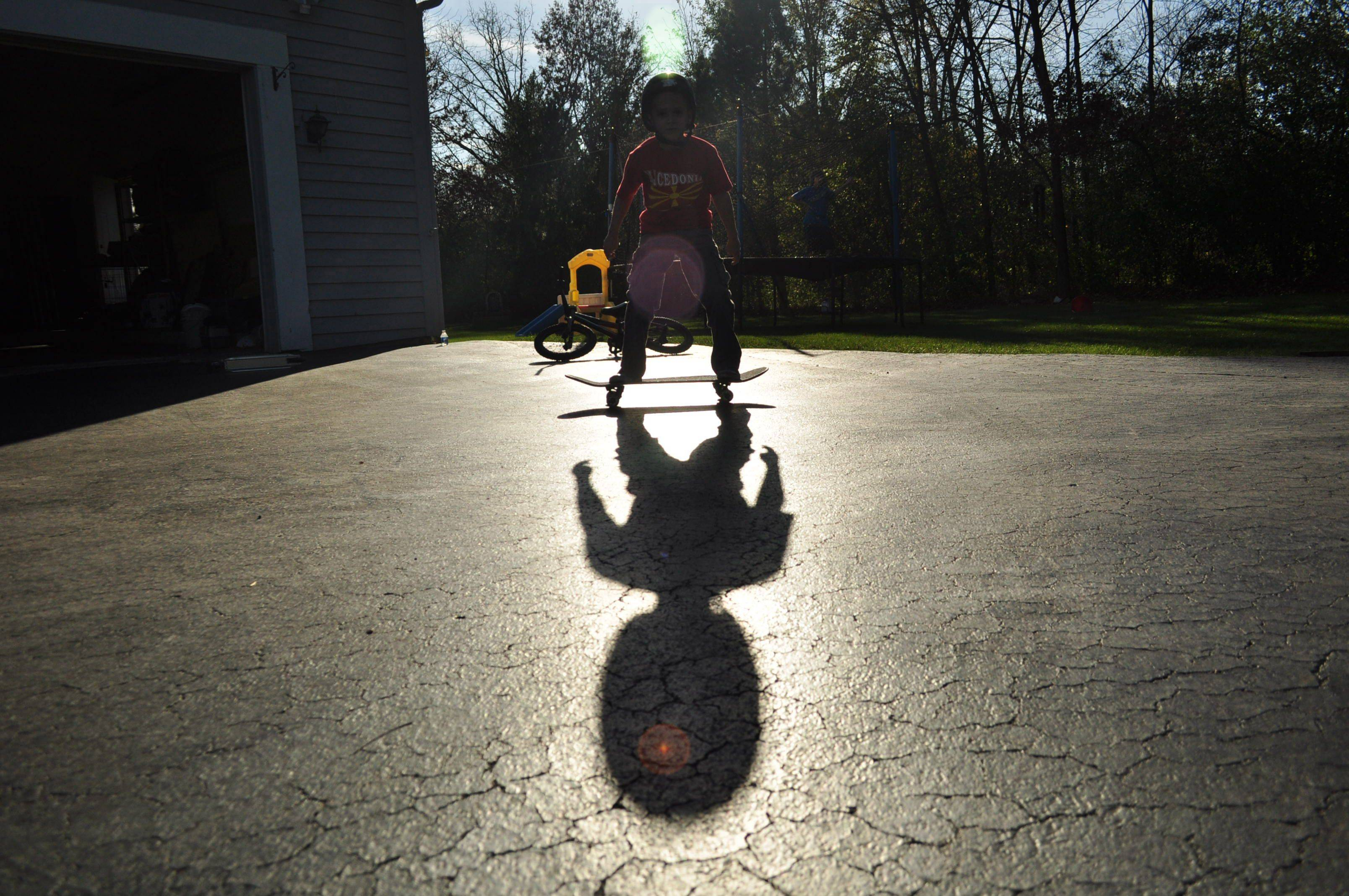 A Mundelein boy tries new tricks in the driveway on his skateboard.
