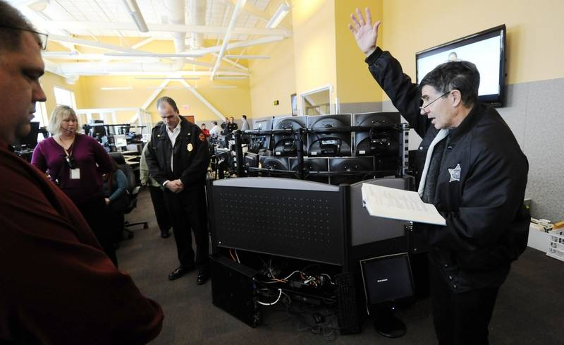 Auroras new 911 dispatch center up and running aurora police chaplain jerry leake blesses auroras new 911 dispatch center wednesday as it became fully thecheapjerseys Image collections