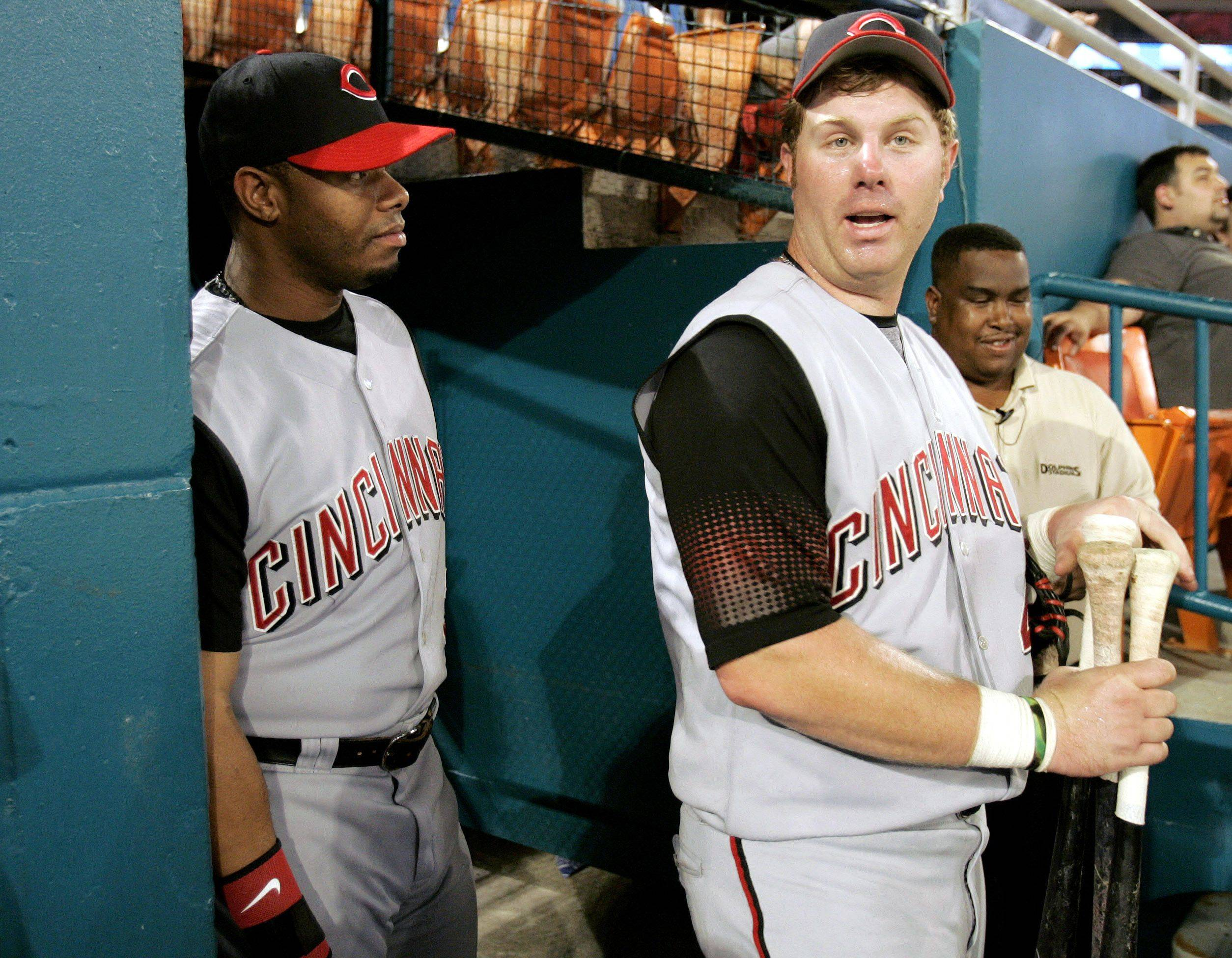 Cincinnati Reds' Ken Griffey Jr., left, talks with outfielder Adam Dunn during a baseball game against the Florida Marlins at Dolphin Stadium in Miami Tuesday, Sept. 26, 2006.