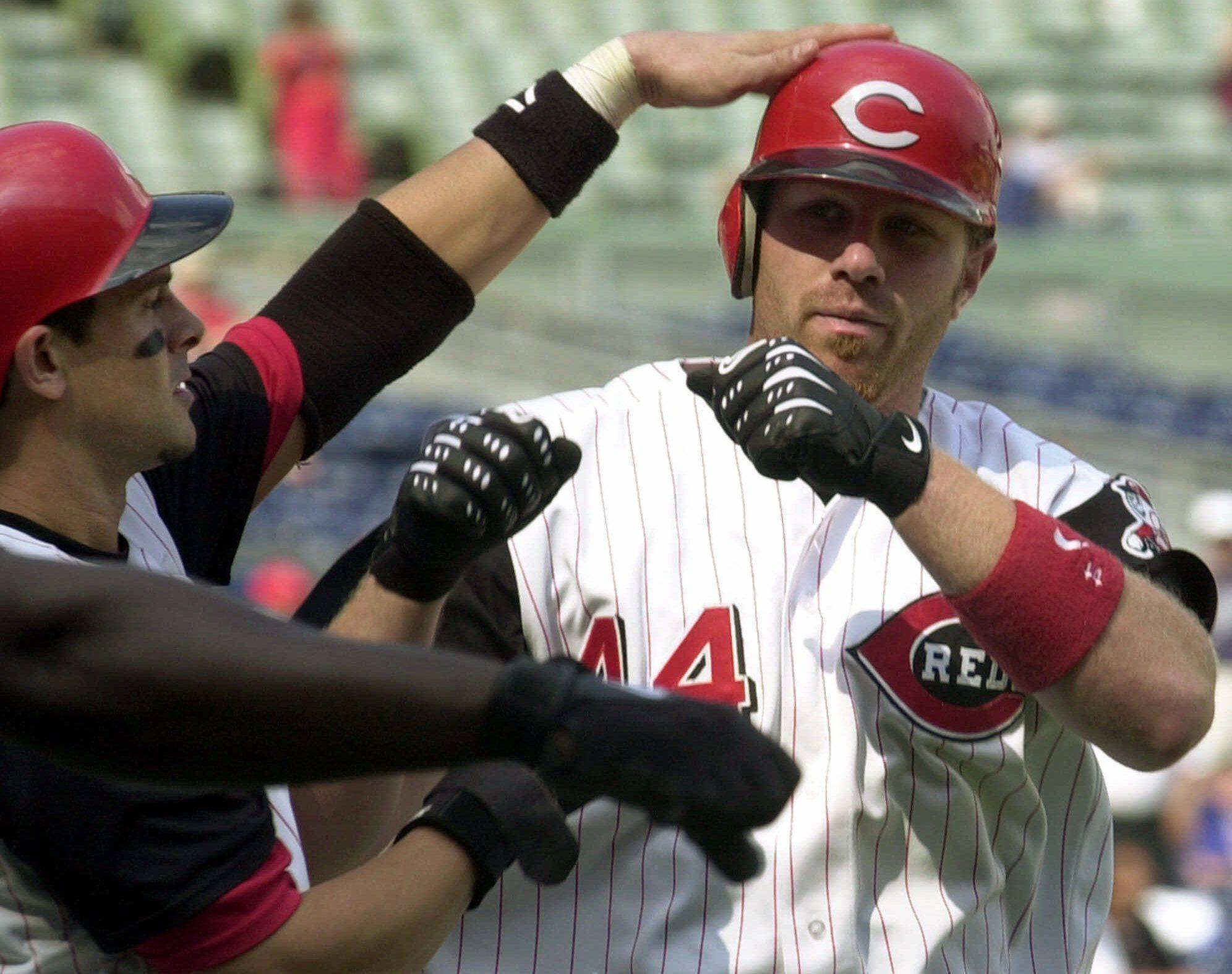 Cincinnati Reds' Adam Dunn, right, is congratulated by teammate Aaron Boone, left, after Dunn hit a two-run home run in the ninth inning against the Chicago Cubs, Thursday, Sept. 20, 2001, in Cincinnati. Chicago won 6-5.