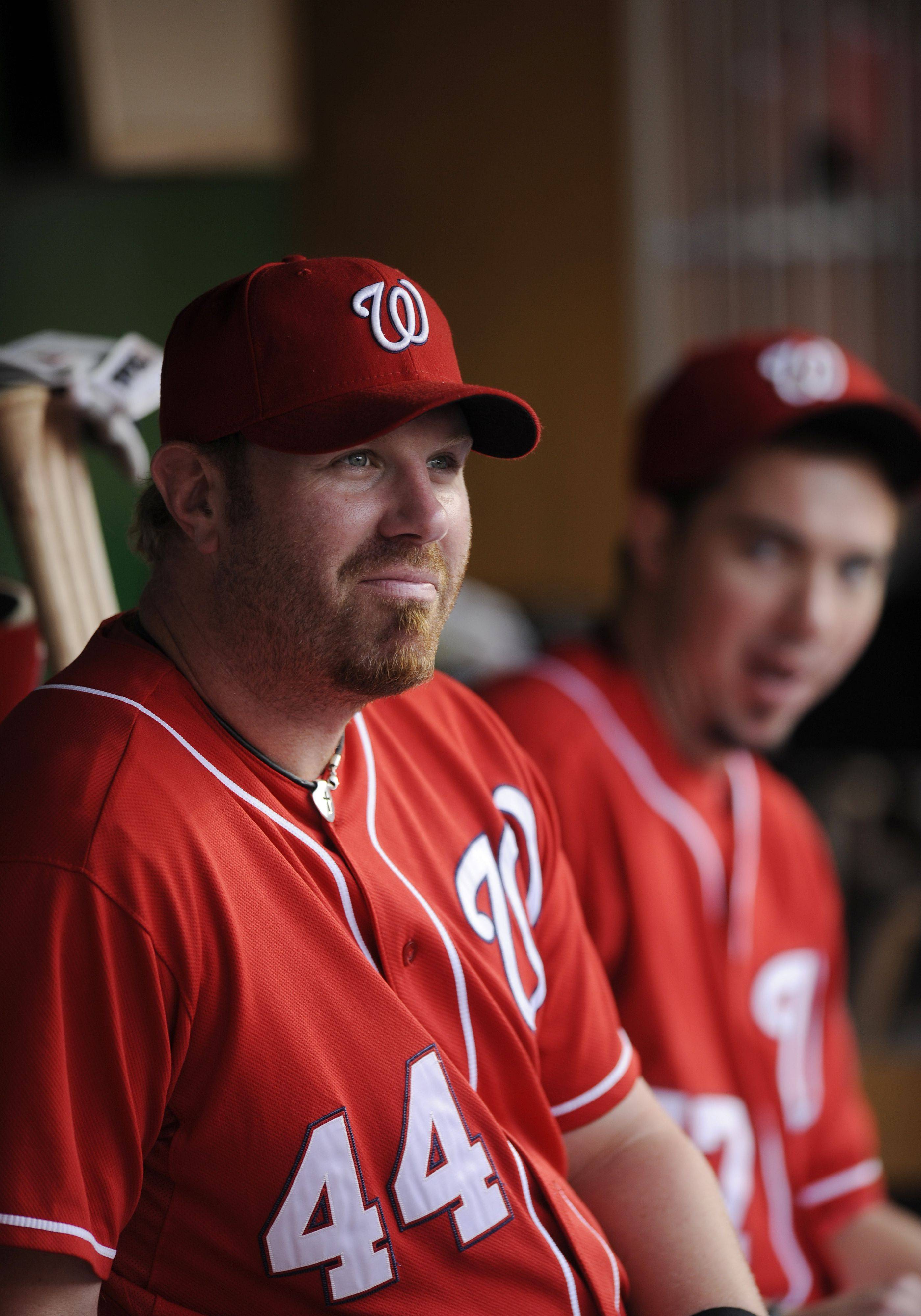 Washington Nationals first baseman Adam Dunn (44) looks out from the dugout before a baseball game against the Philadelphia Phillies.