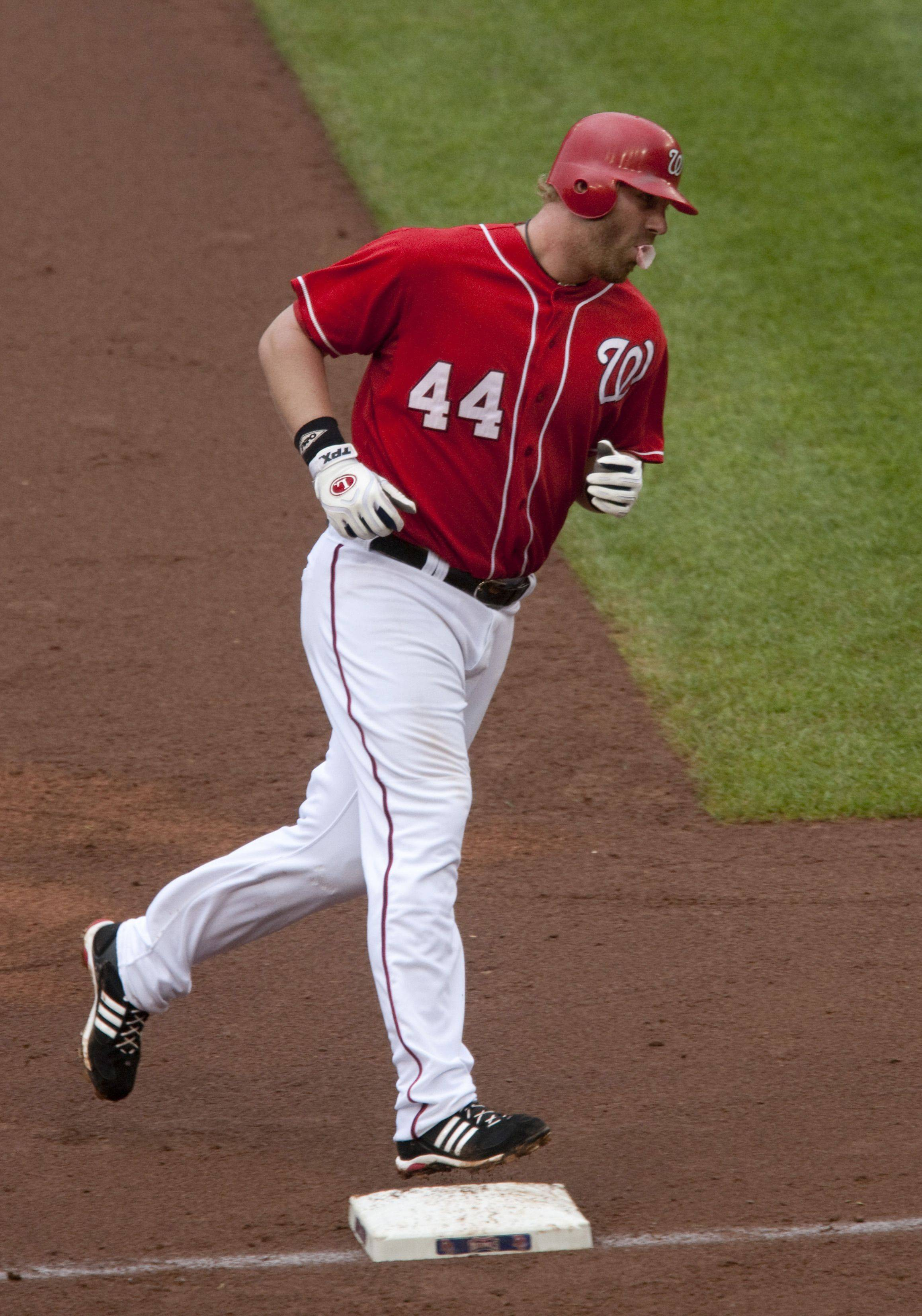Washington Nationals' Adam Dunn rounds third base after hitting a two-run home run during the sixth inning of a baseball game against the Philadelphia Phillies.