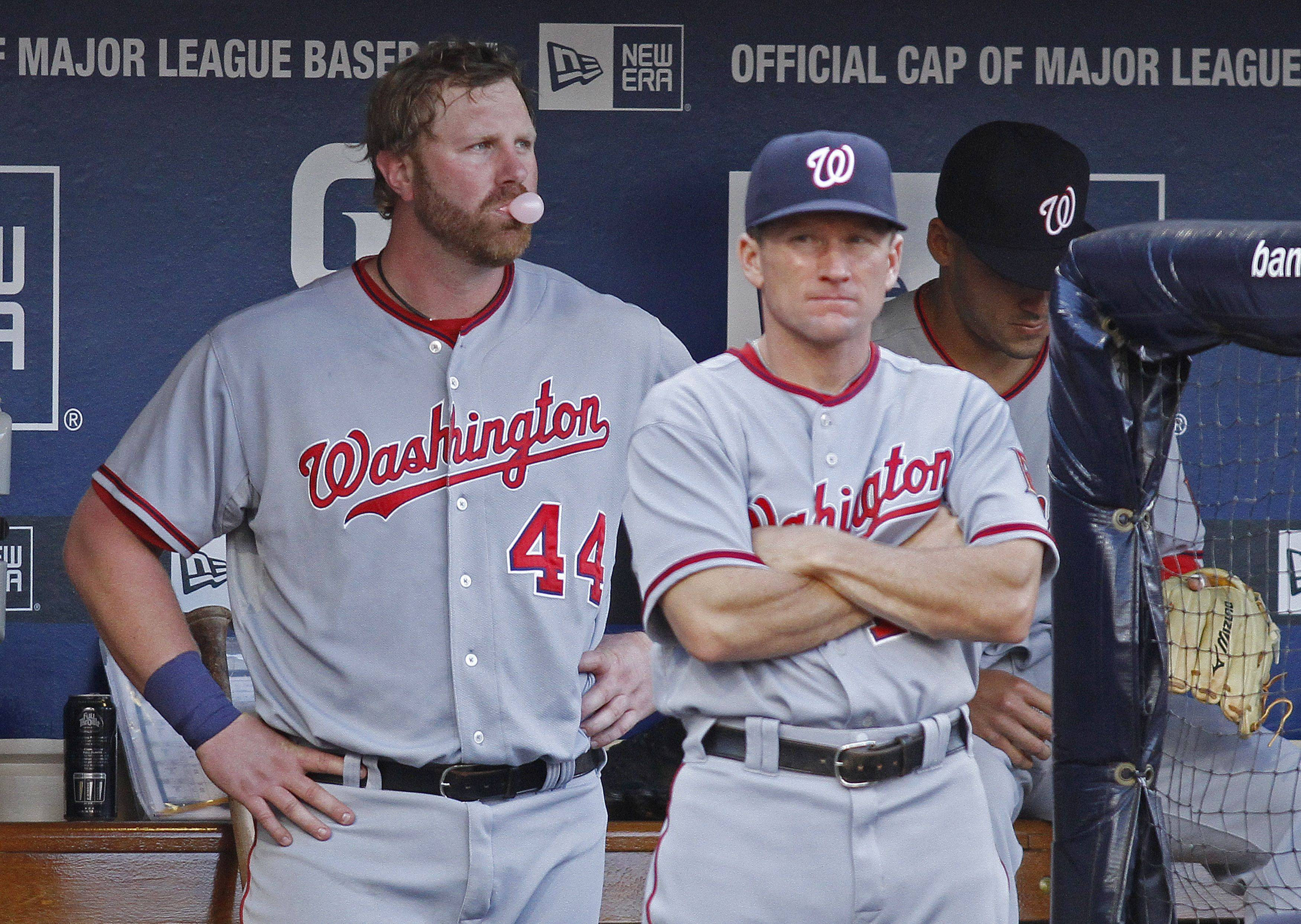 Washington Nationals Adam Dunn, left, and batting coach Rick Eckstein, right, look on after Dunn struck out against the San Diego Padres.